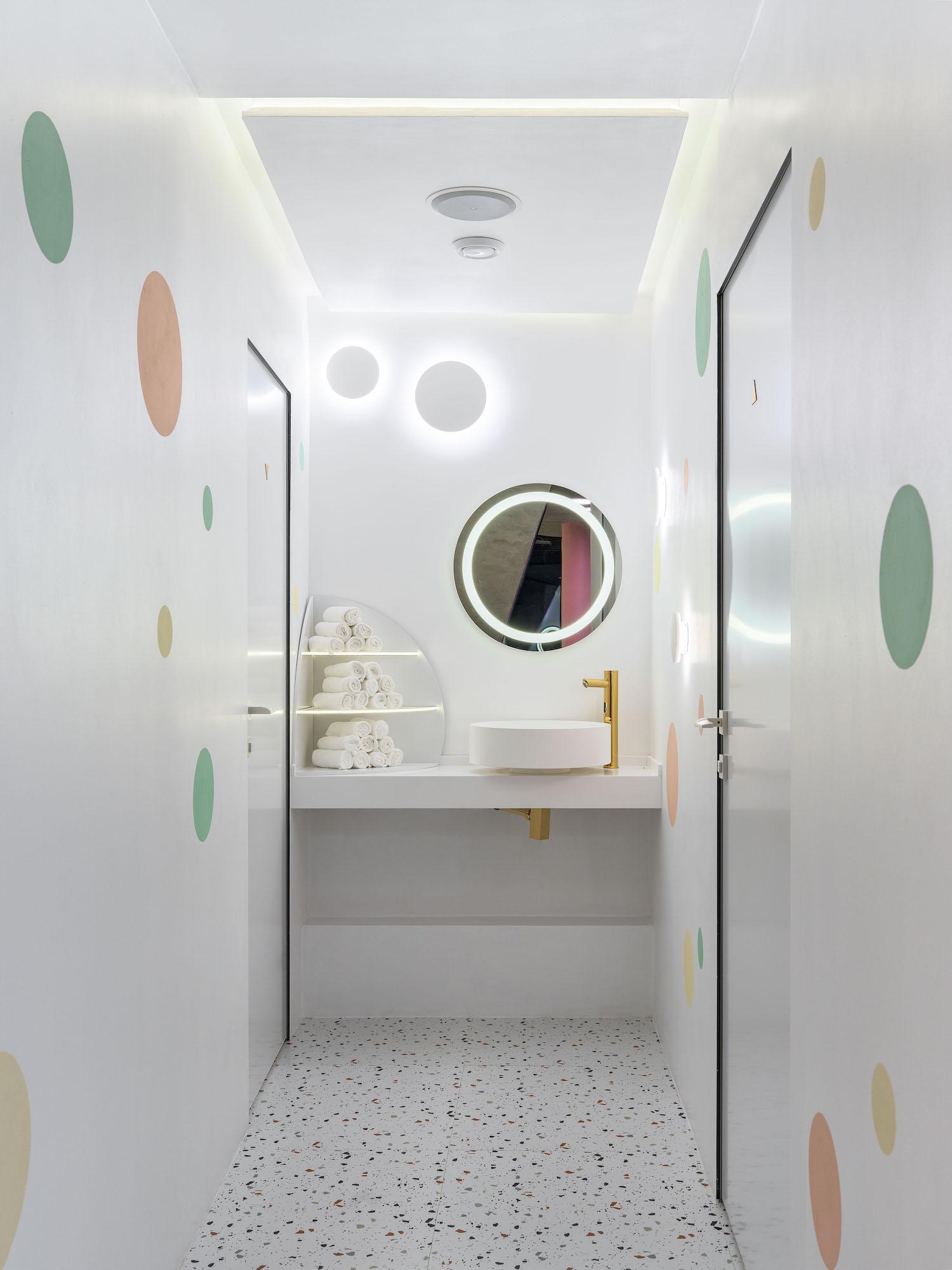 white bathroom with ceramic washing basins