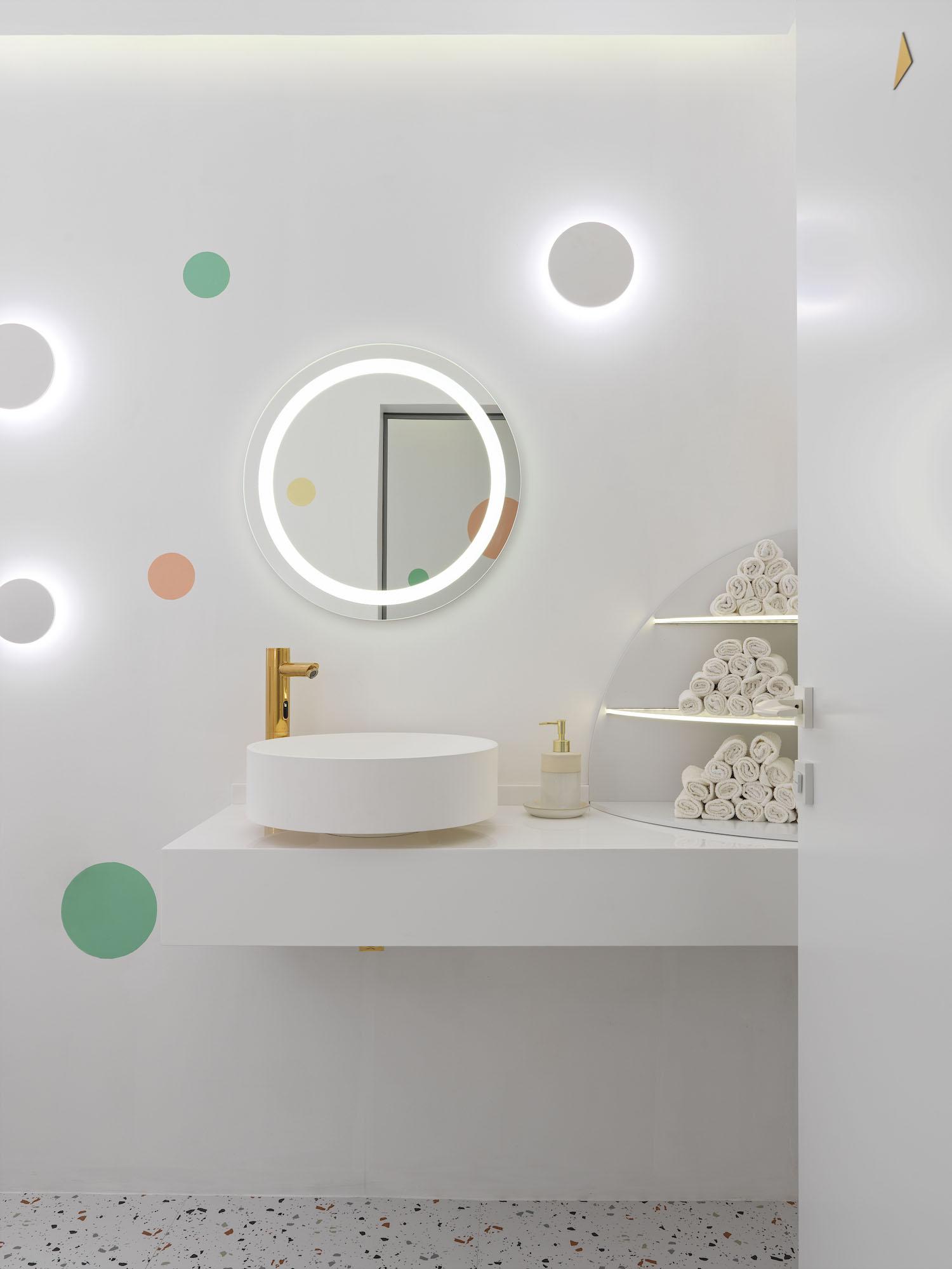 white circular washing basin with circular mirror
