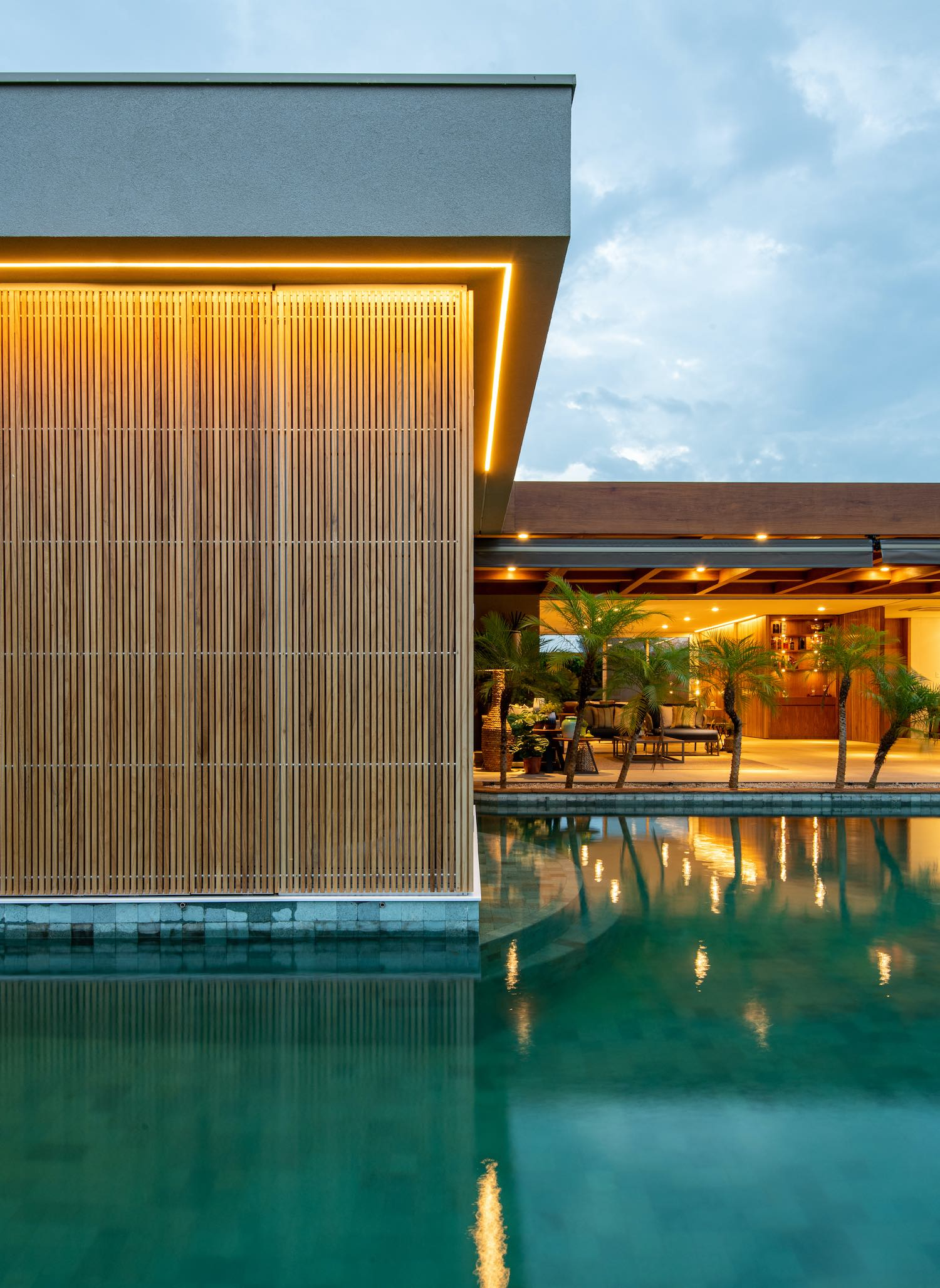 wooden facade house surrounded with pool