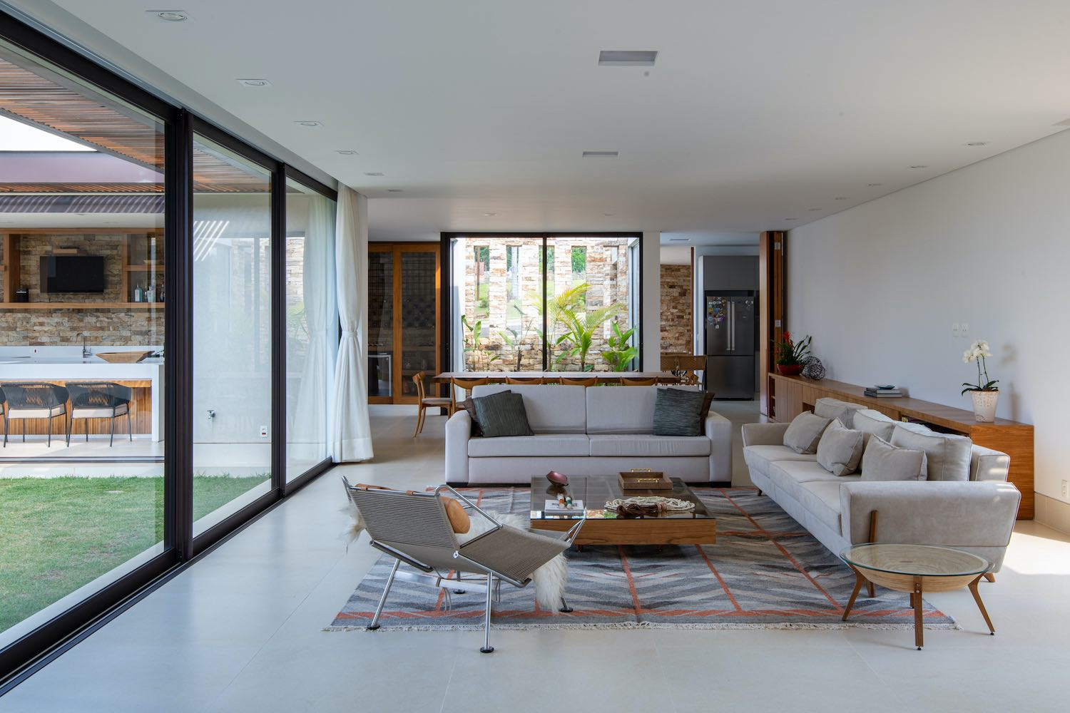 furnished living room with large windows