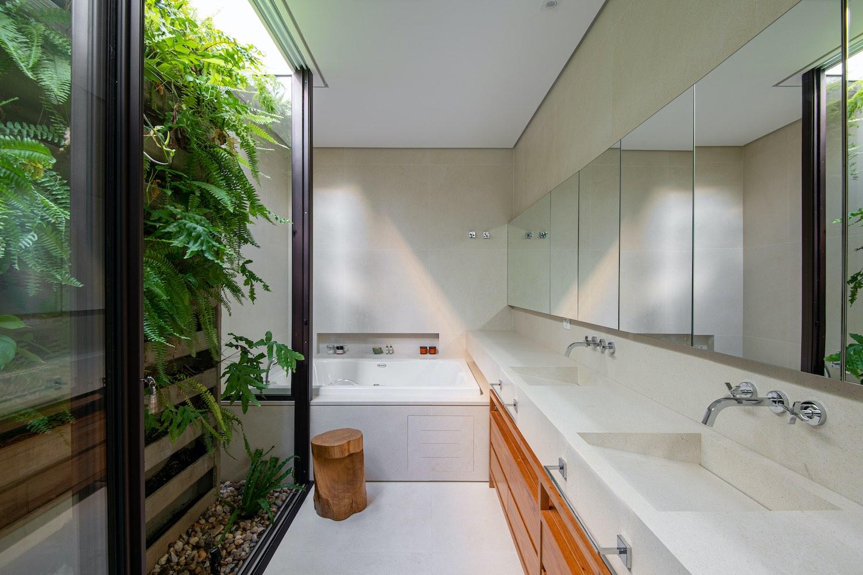bathroom with windows and indoor patio