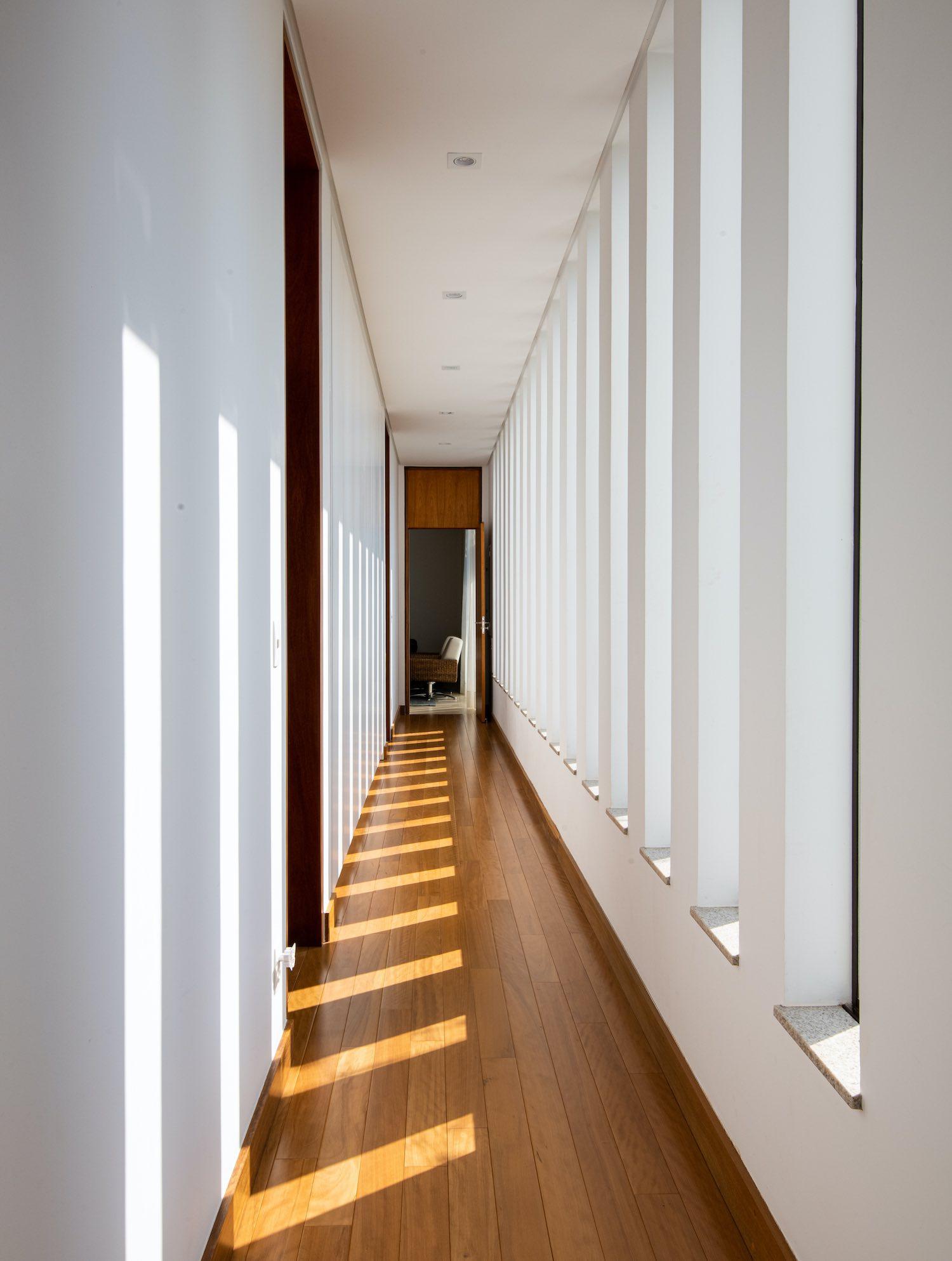 corridor with lathe windows and curtain