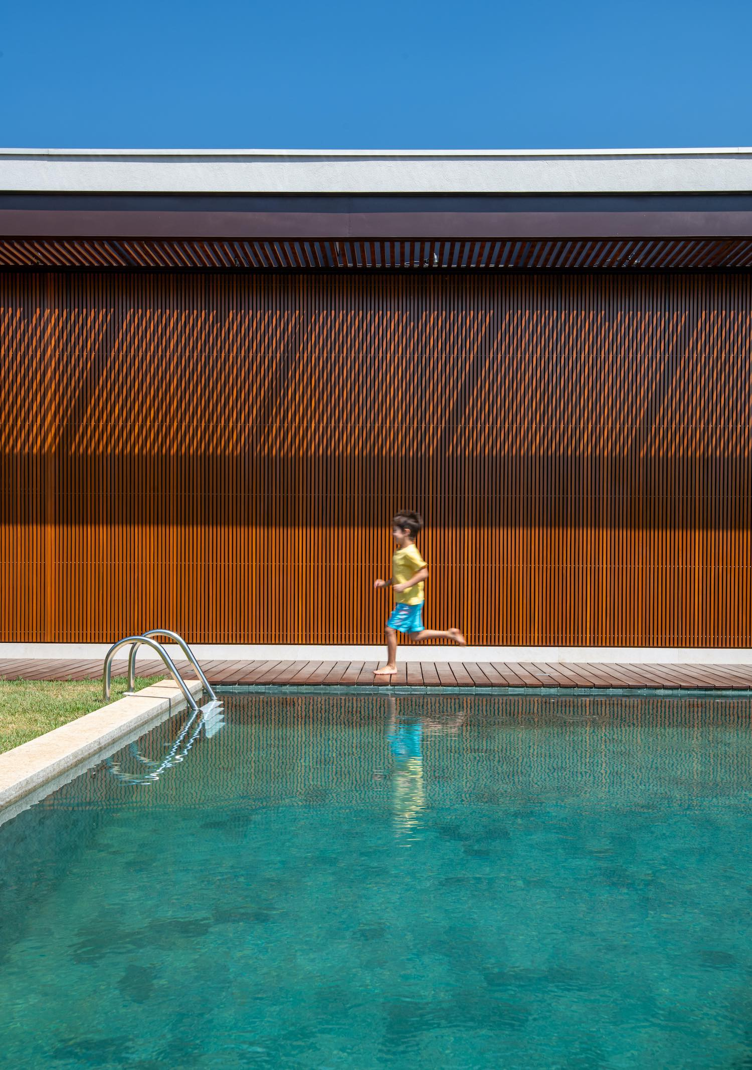 boy playing near swimming pool