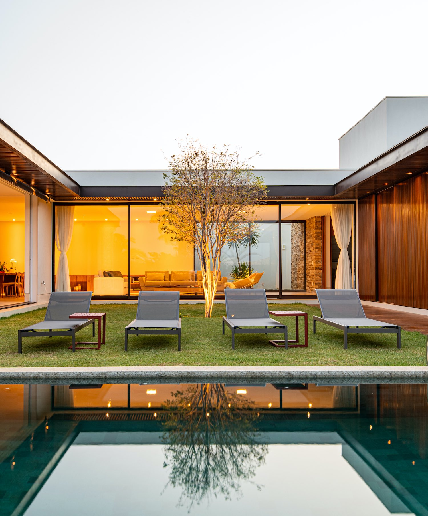 reflection of the tree and house in the pool