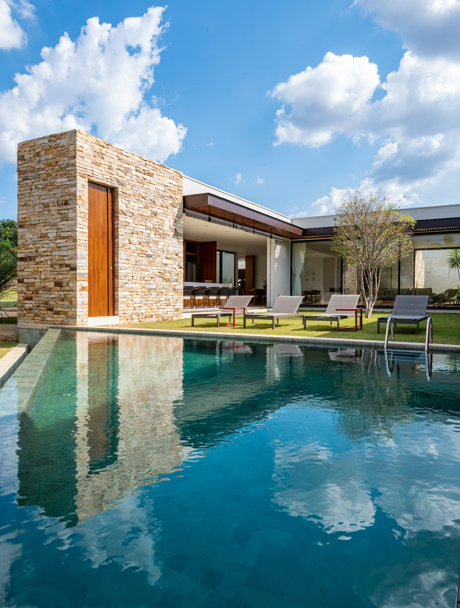 reflection of stone house in the pool