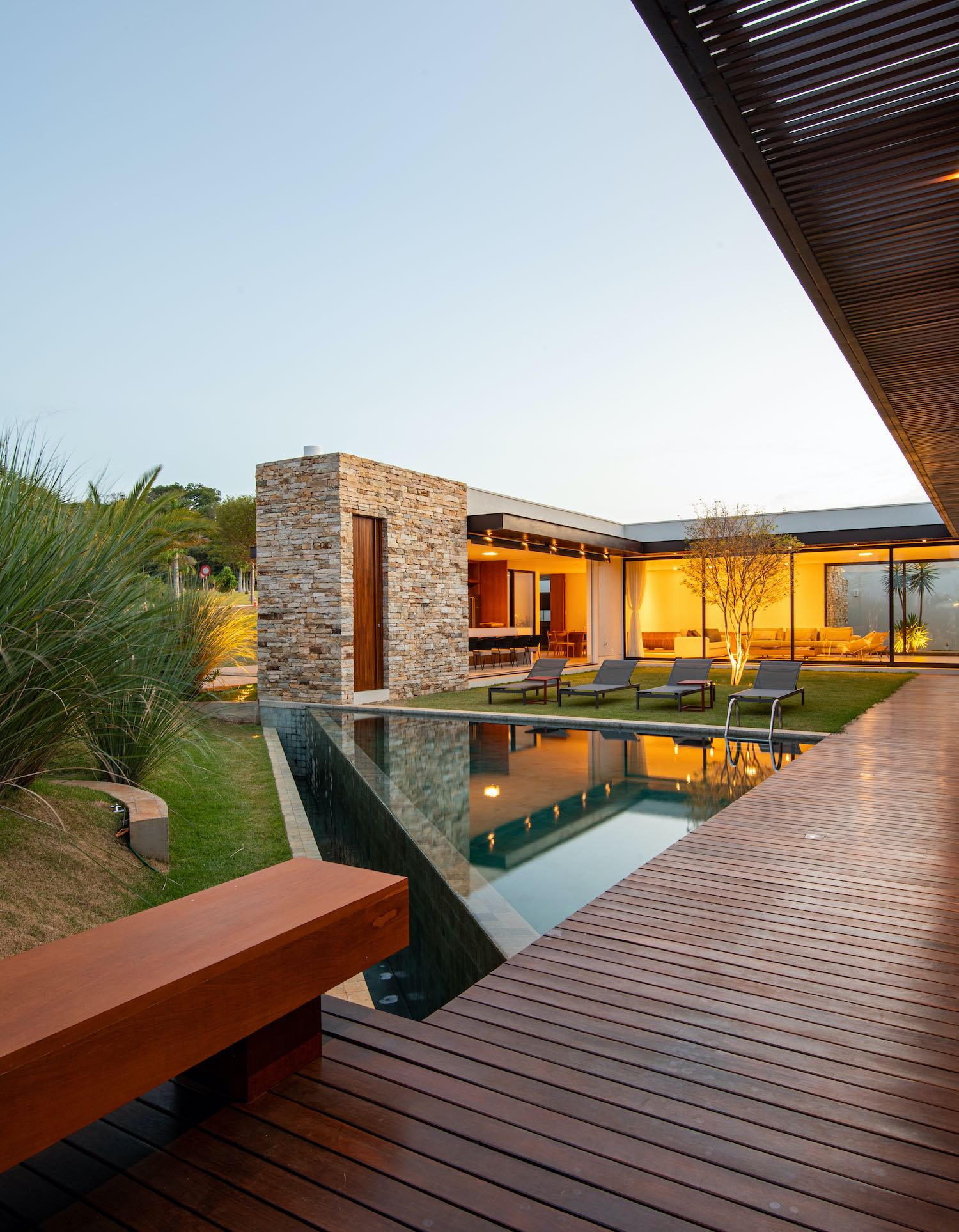 stone house with pool and green landscape