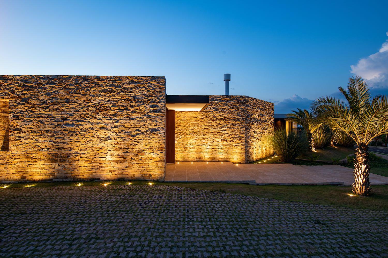 light hitting the stone wall at night