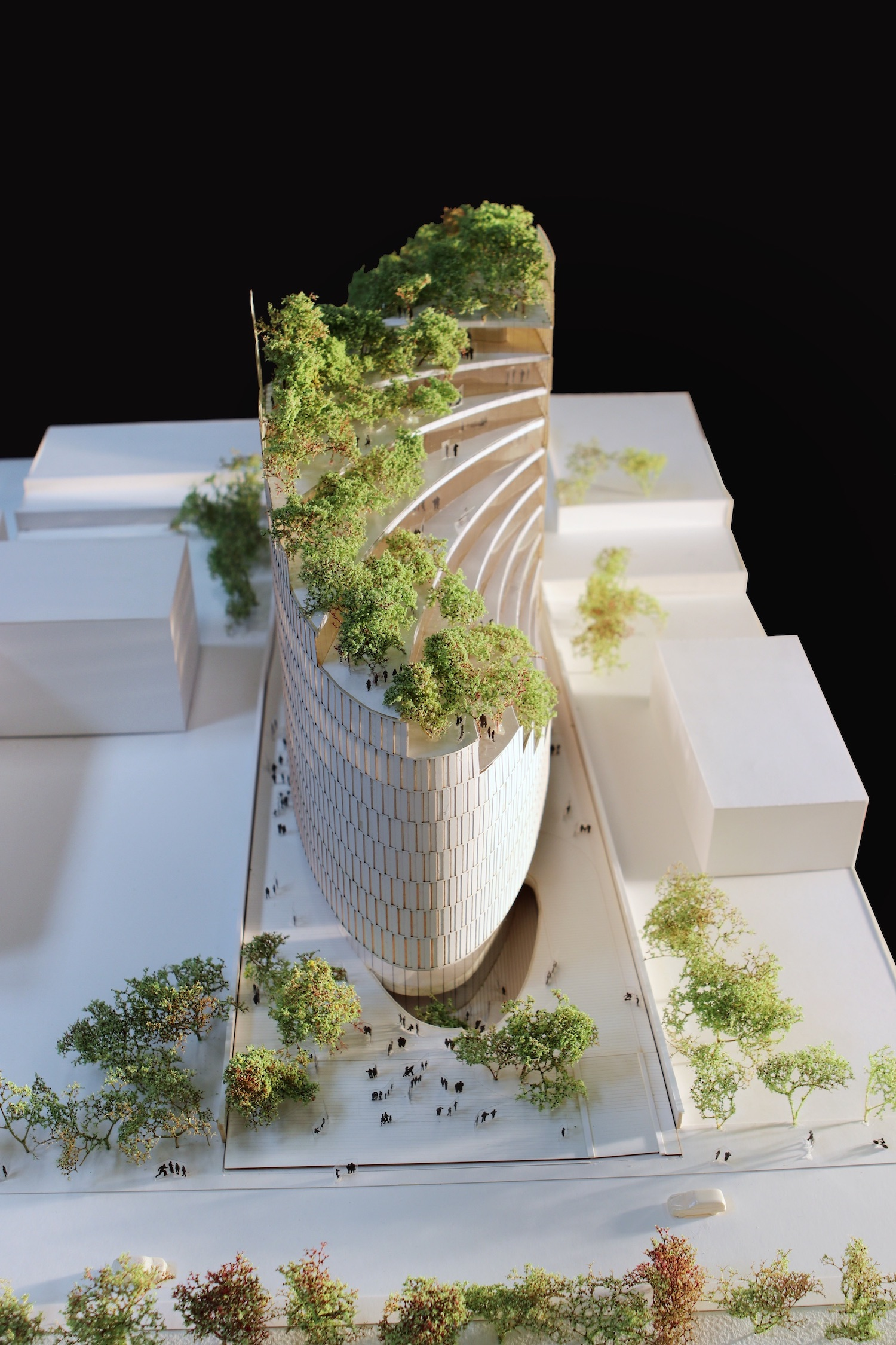 architectural model of a tower with layered green terraces