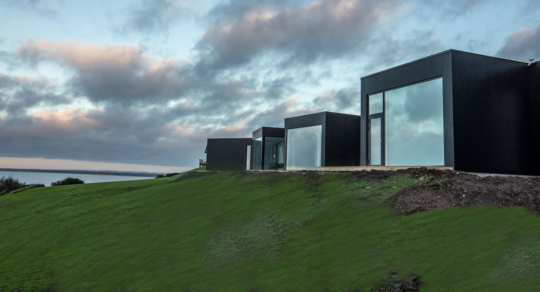 house on a green hill toward the sea