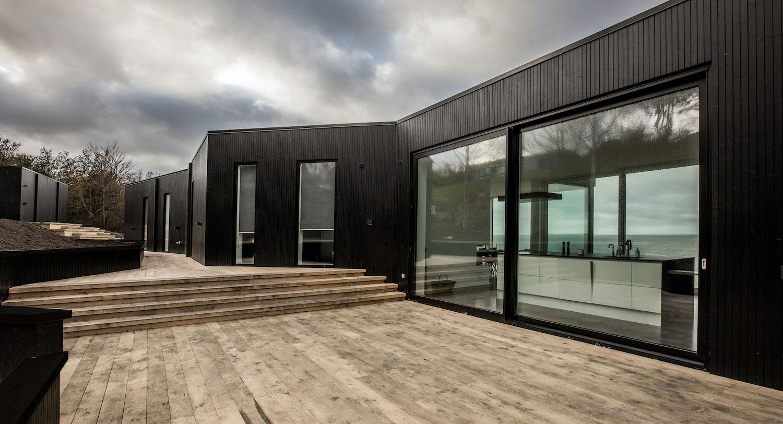 black house with oak deck