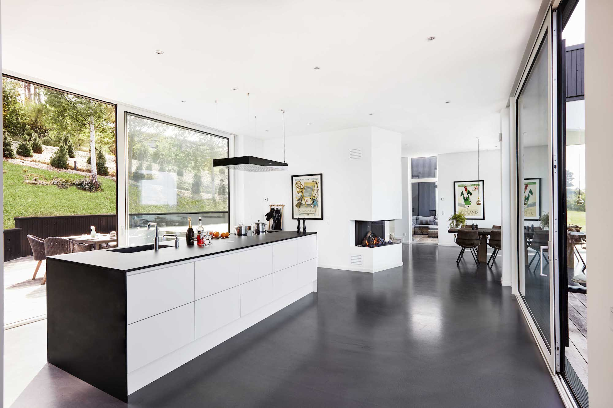 fireplace located near the white modern kitchen