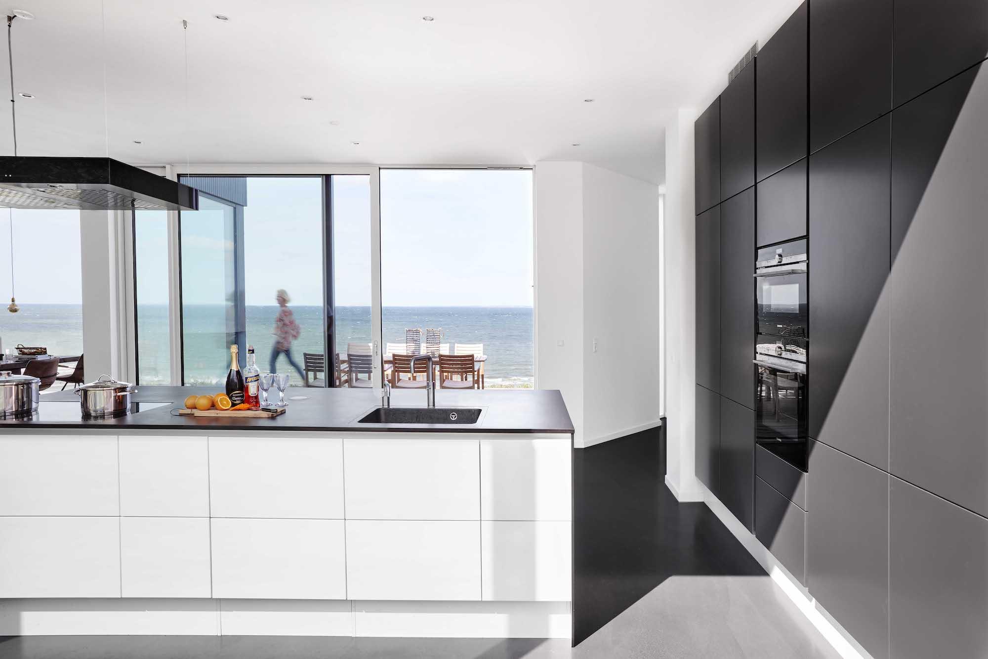 sun light enters the kitchen through large windows