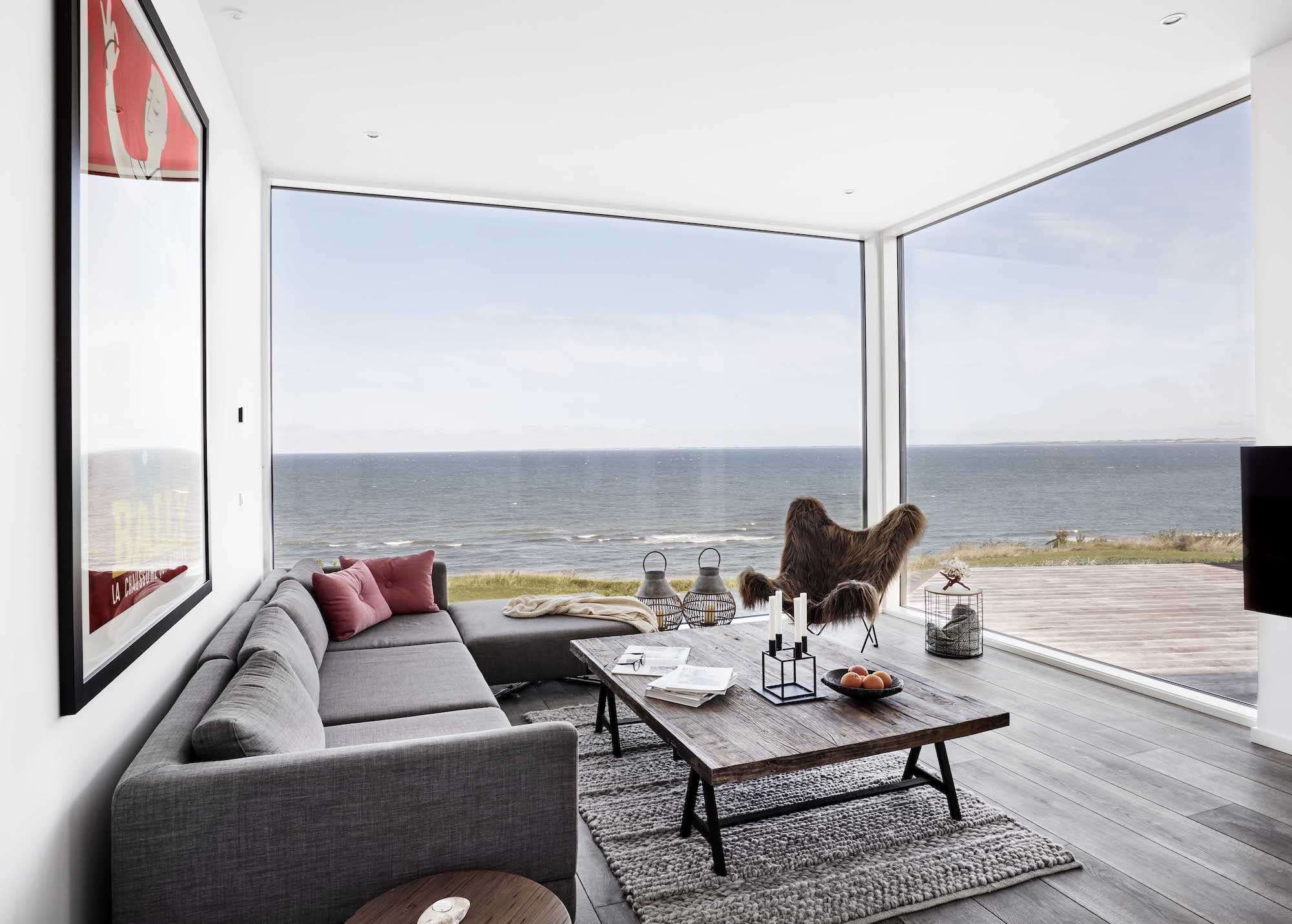 living room with sofa and wooden table has spectacular sea view