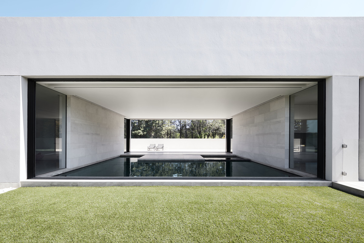 The inside pool shown from the both side of the house
