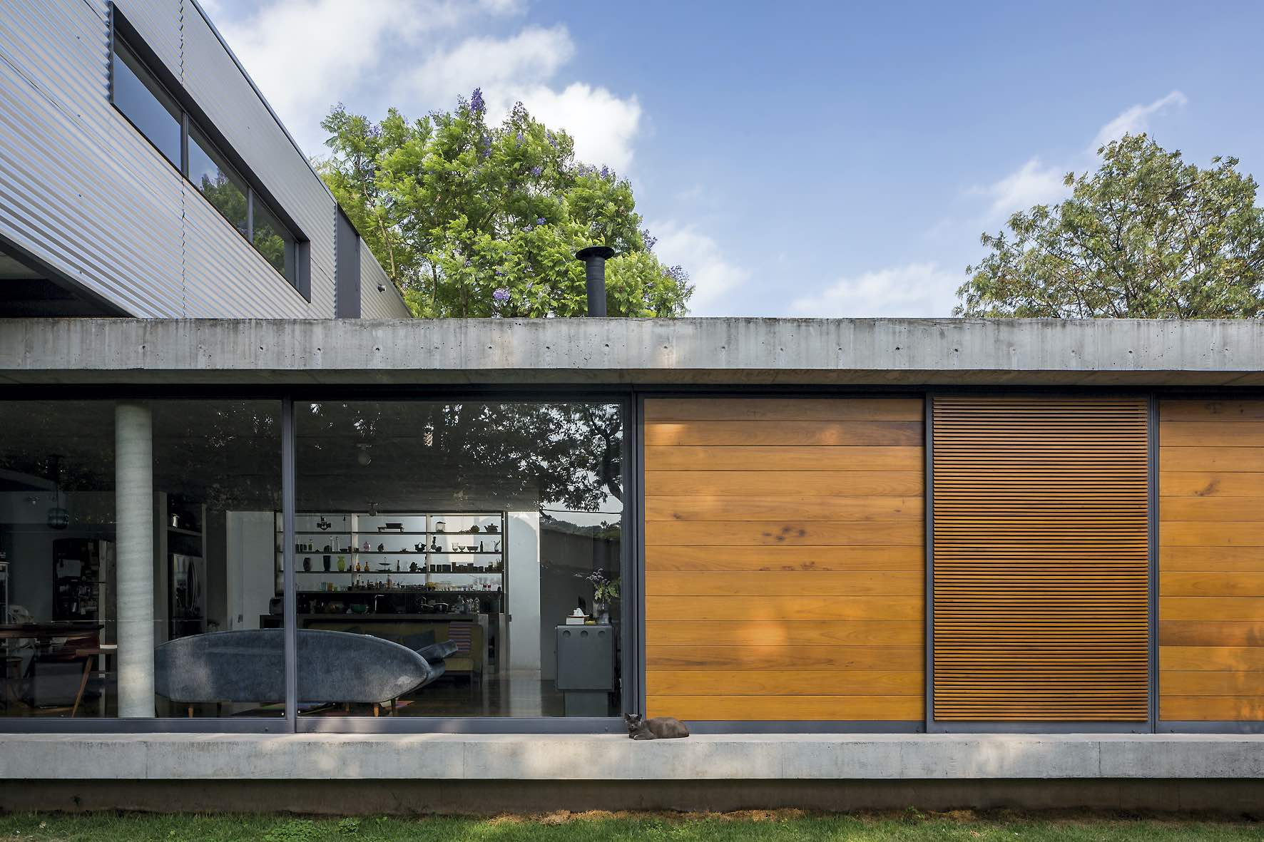 wood , glass and concrete used for the exterior design