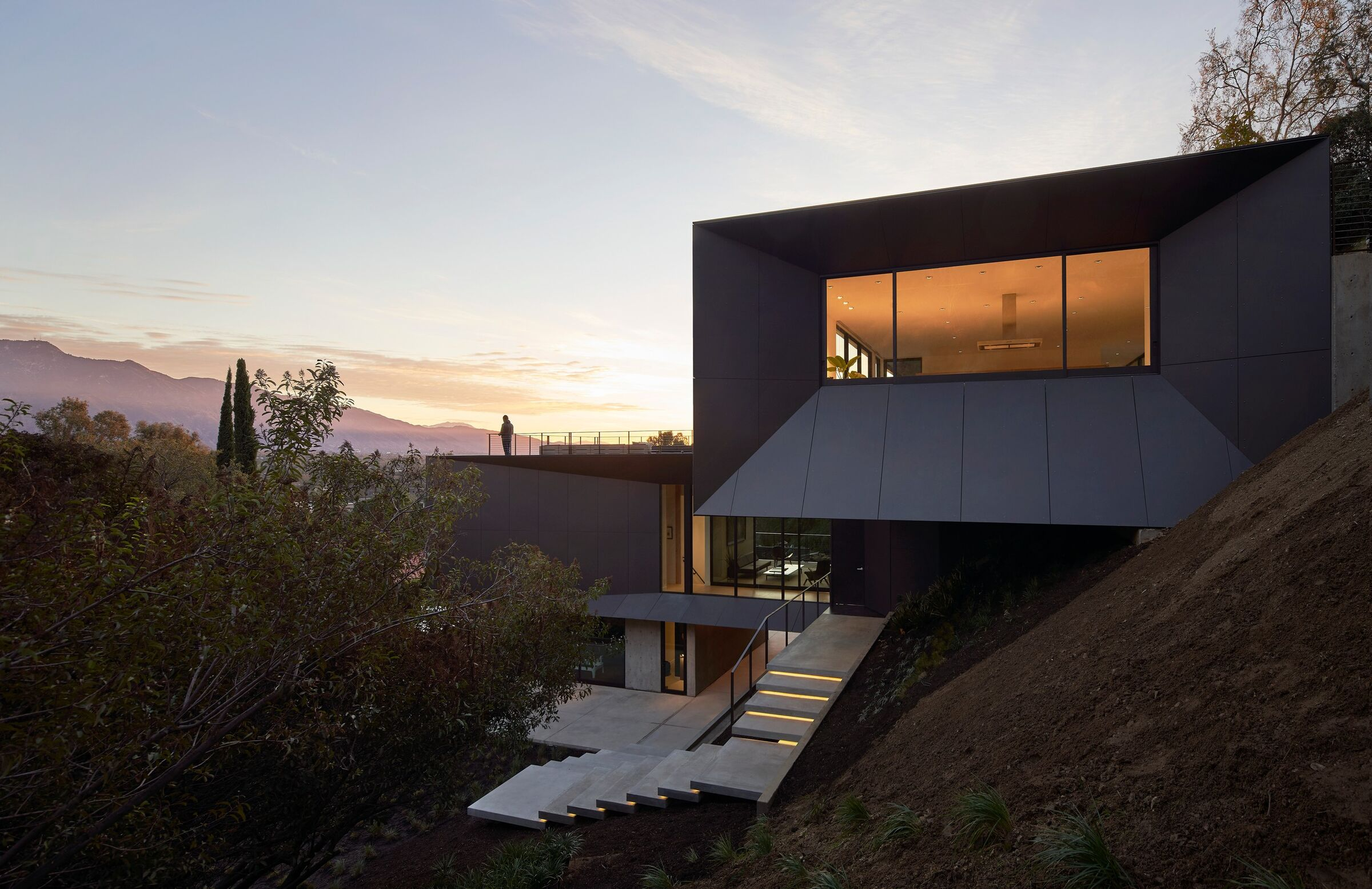 concrete steps of he house illuminated with led lighting