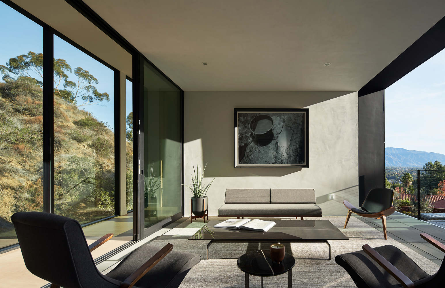 living room with big glass windows let the sunlight enters the room