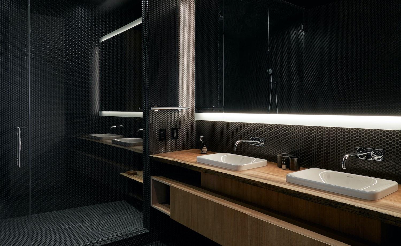 bathroom with washing basin and black walls