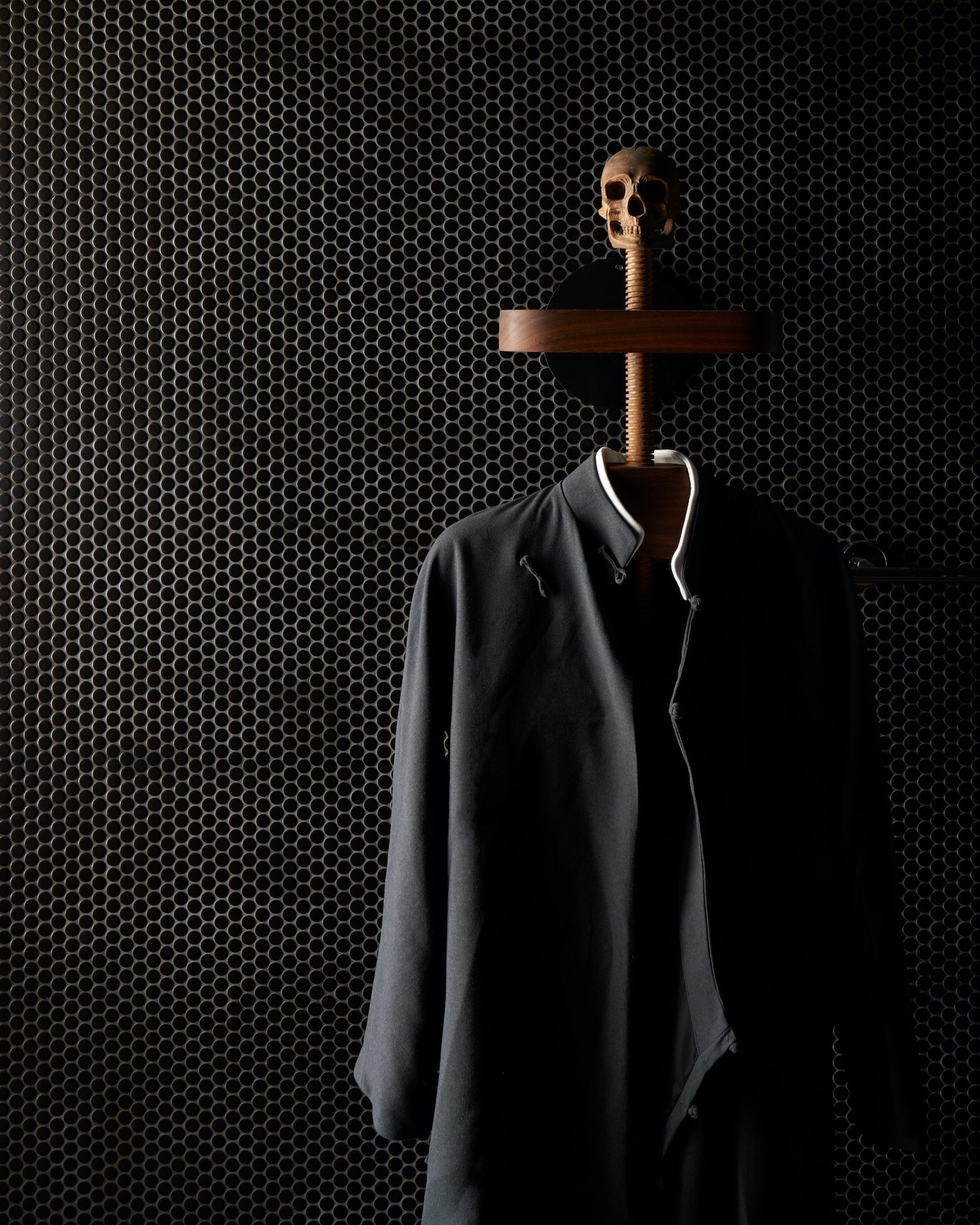 black suit and black wall