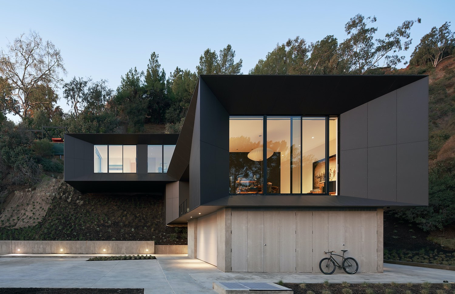 hillside house with black colored facade