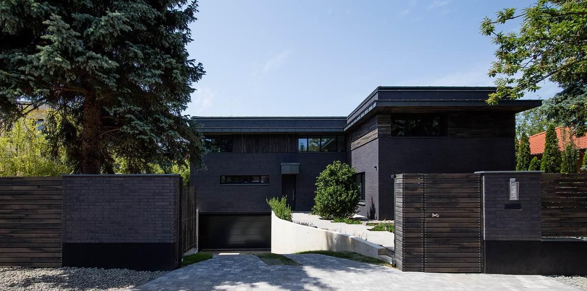 a black villa for a single family with huge garden