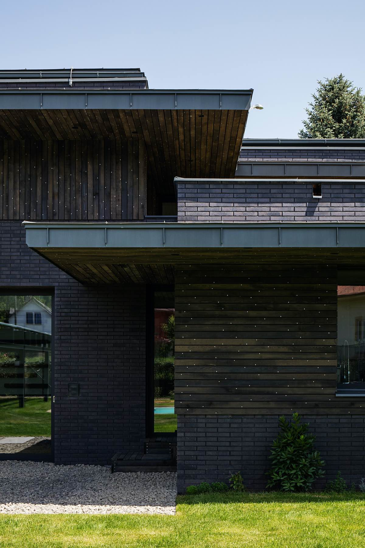 combination of brick wood and metal used in the exterior design