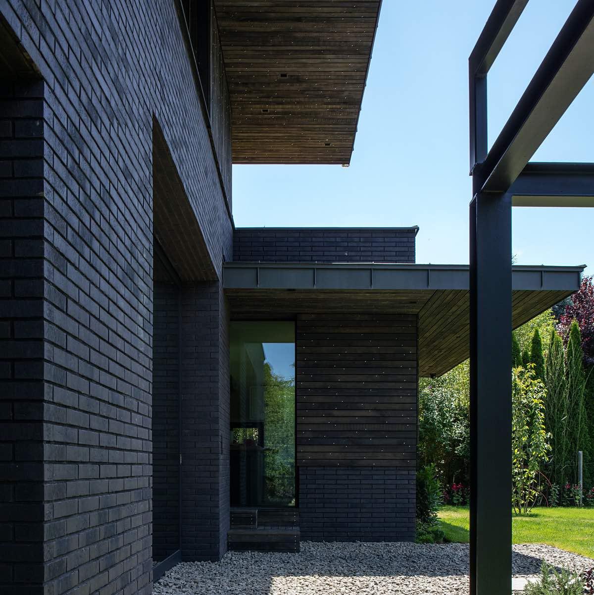 amazing villa with dark brick and glass