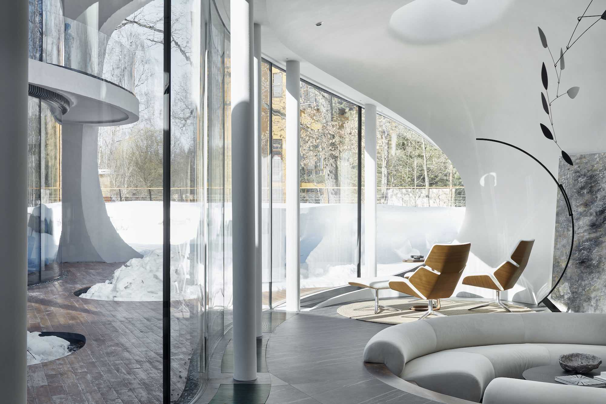 sunlight enter the house through curvy glass windows