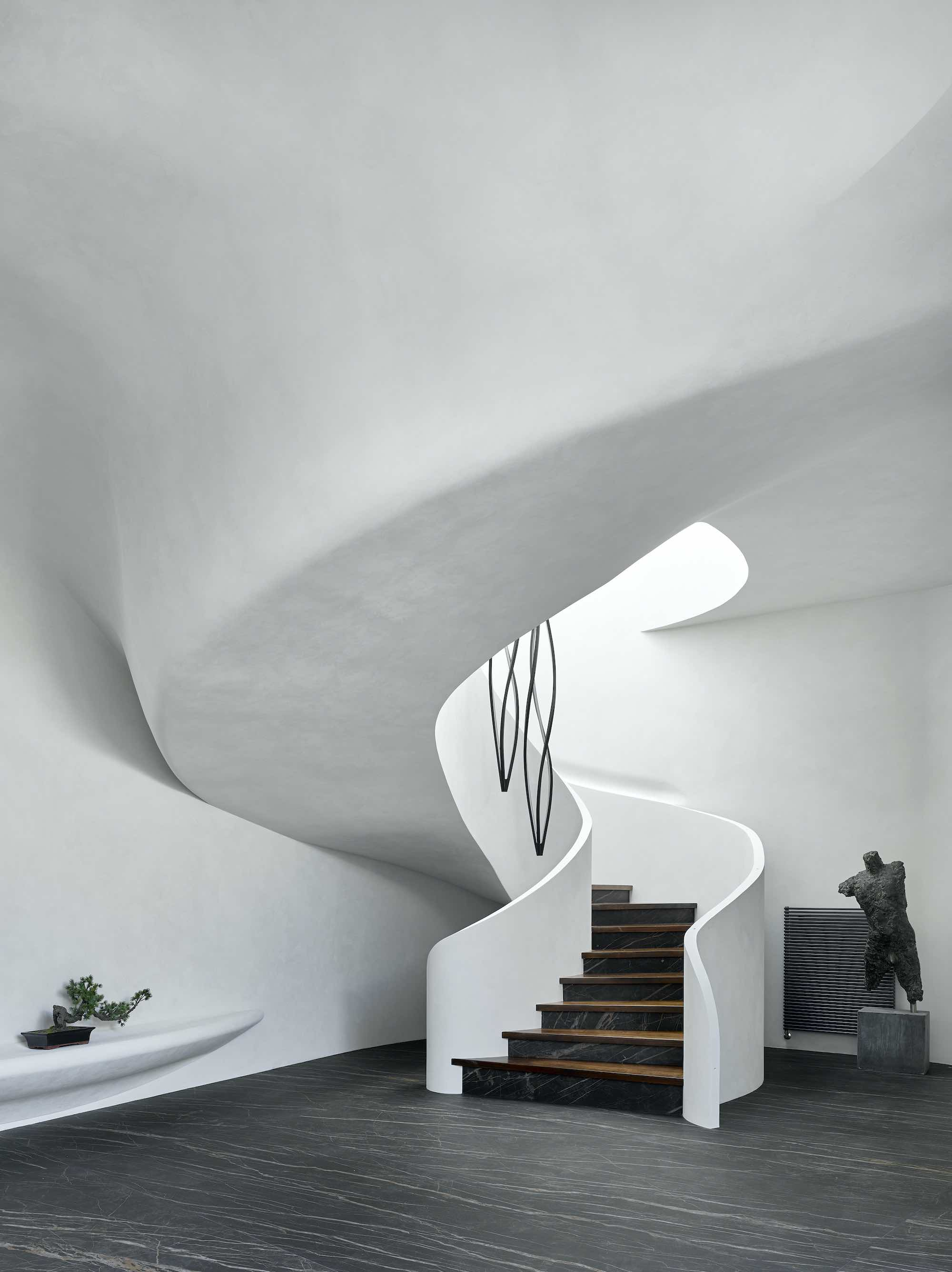 spiral white staircase made of stucco