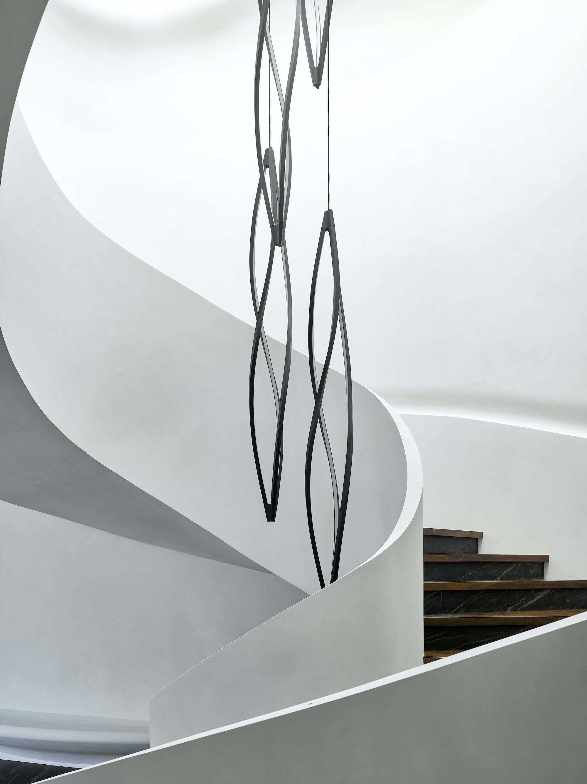 metal sculpture hanged over staircase
