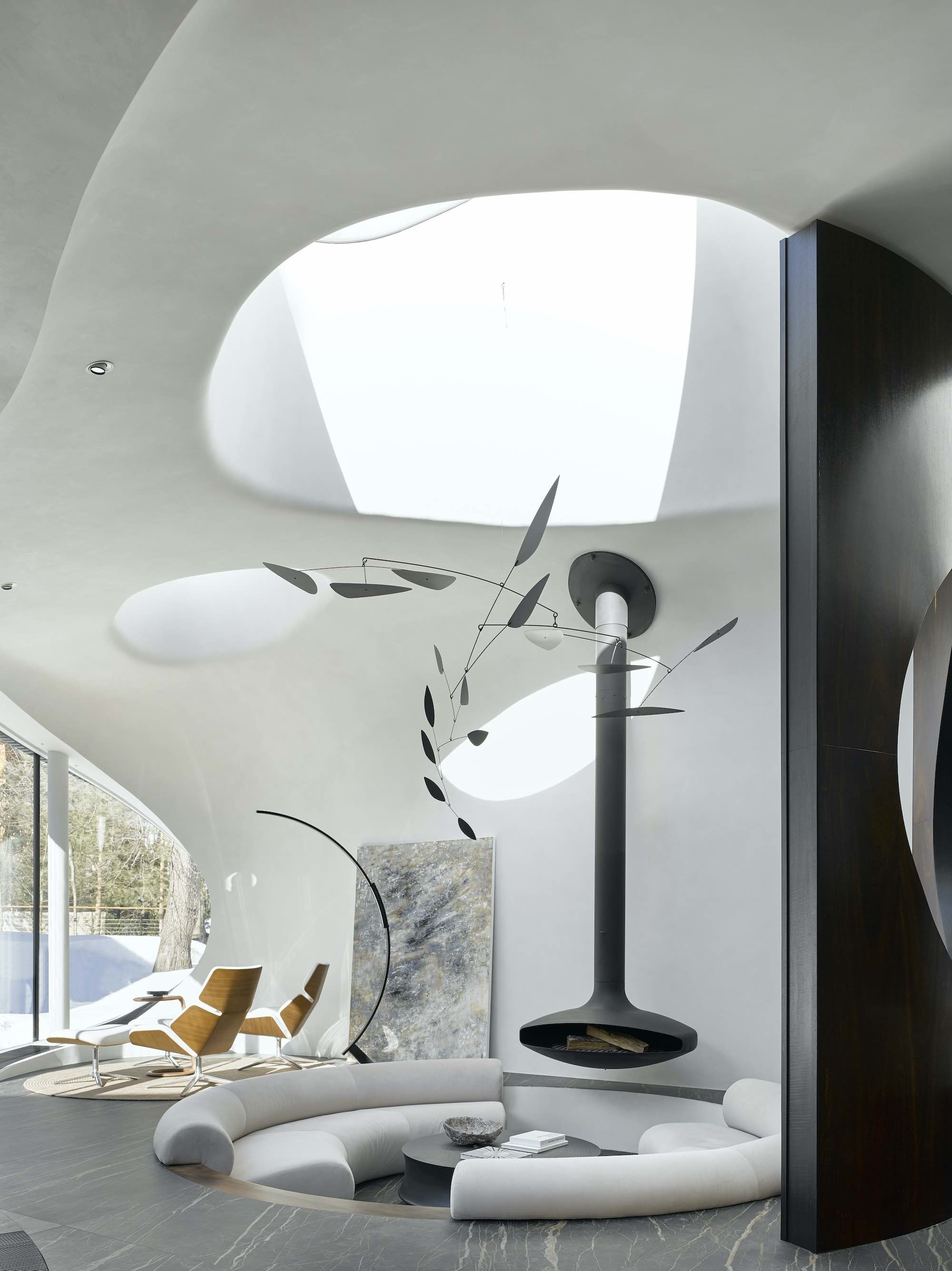 a circular living space with black metallic chimney