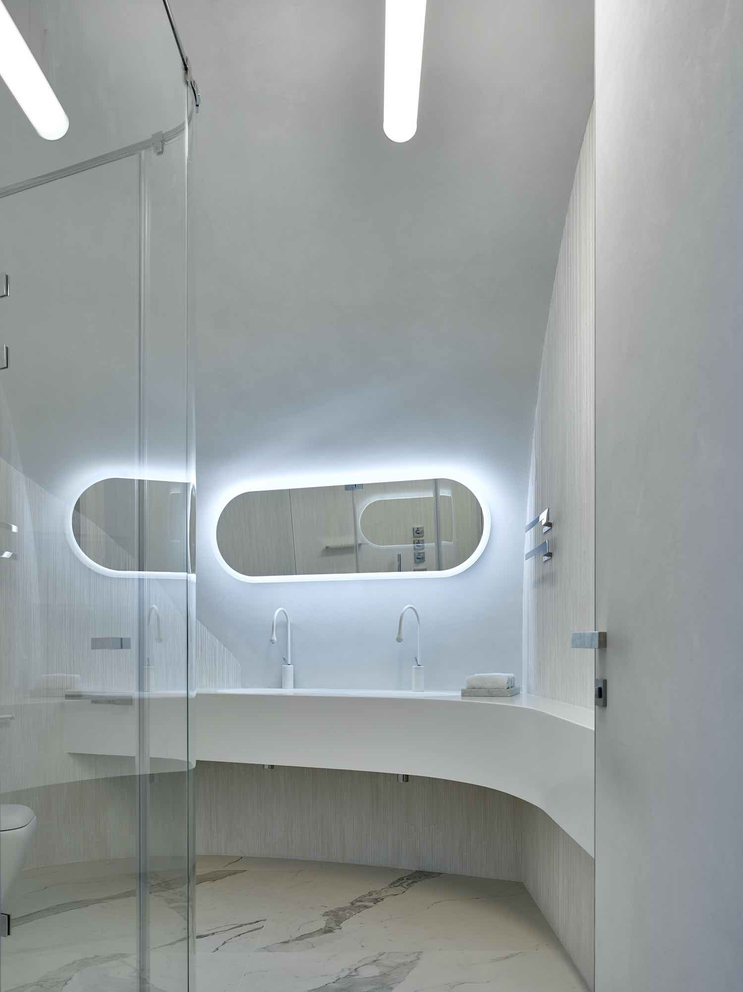 an elliptical mirror with illumination