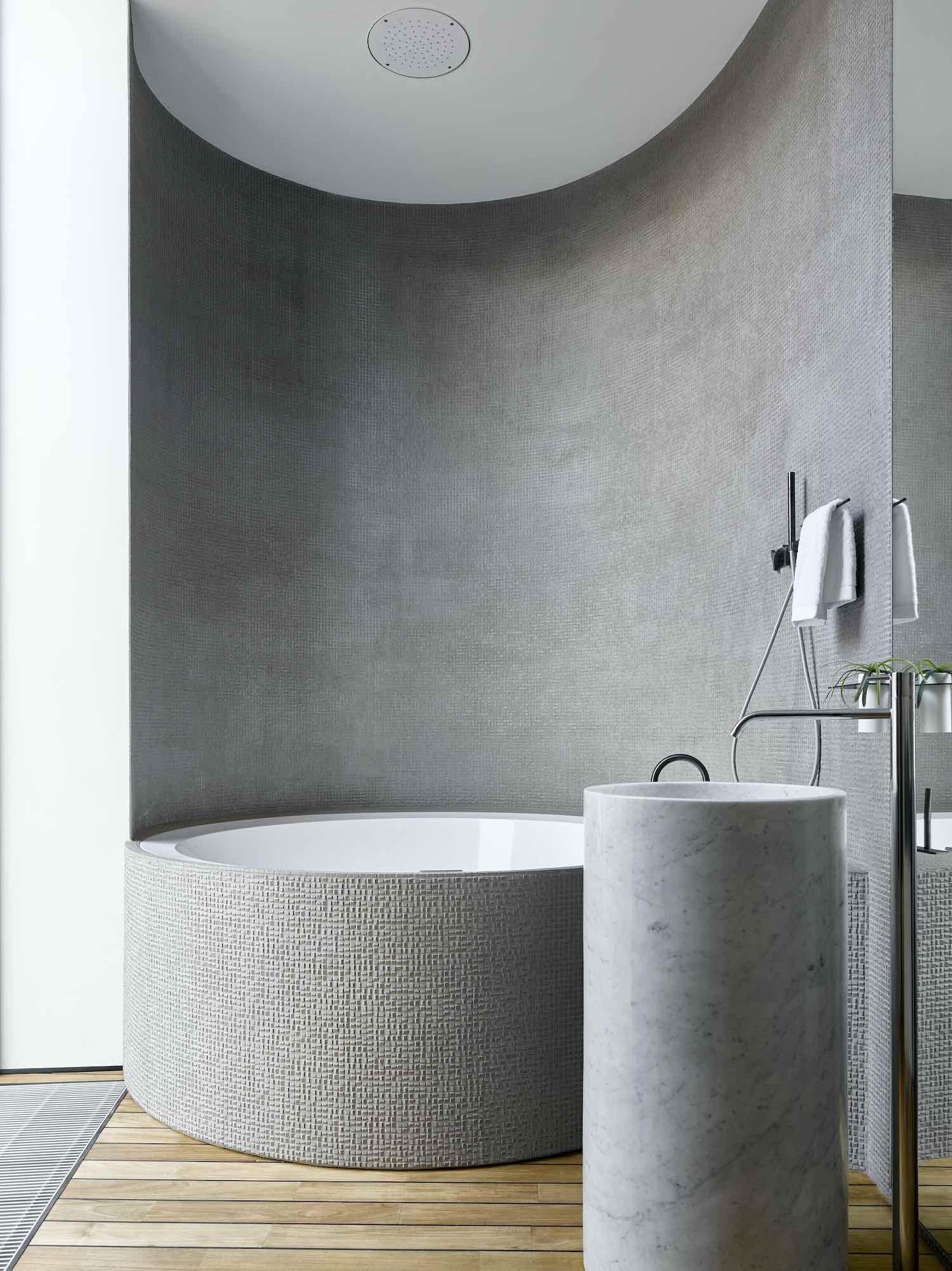 a bathroom with circular bathtub