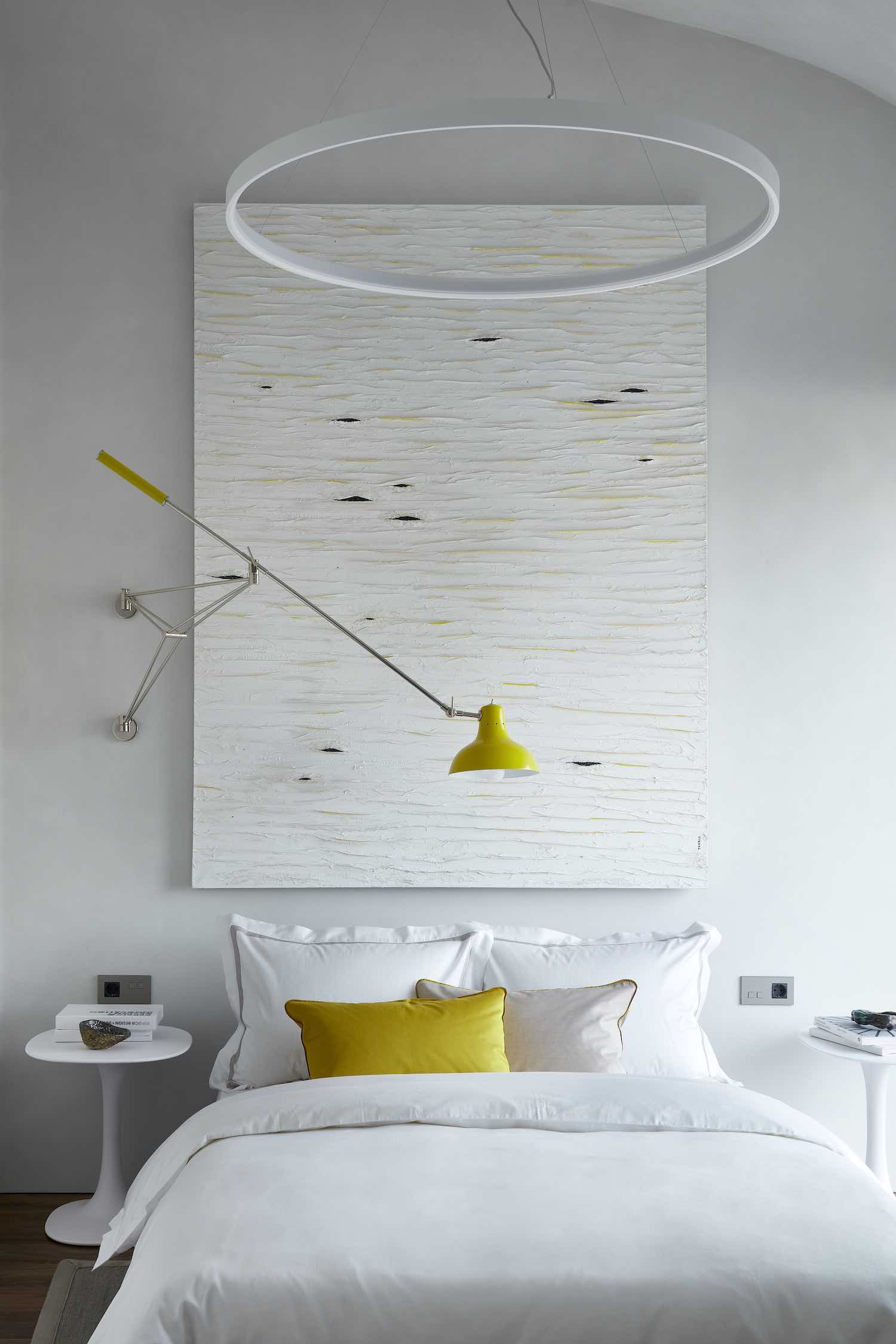 white bed and yellow bed lamp