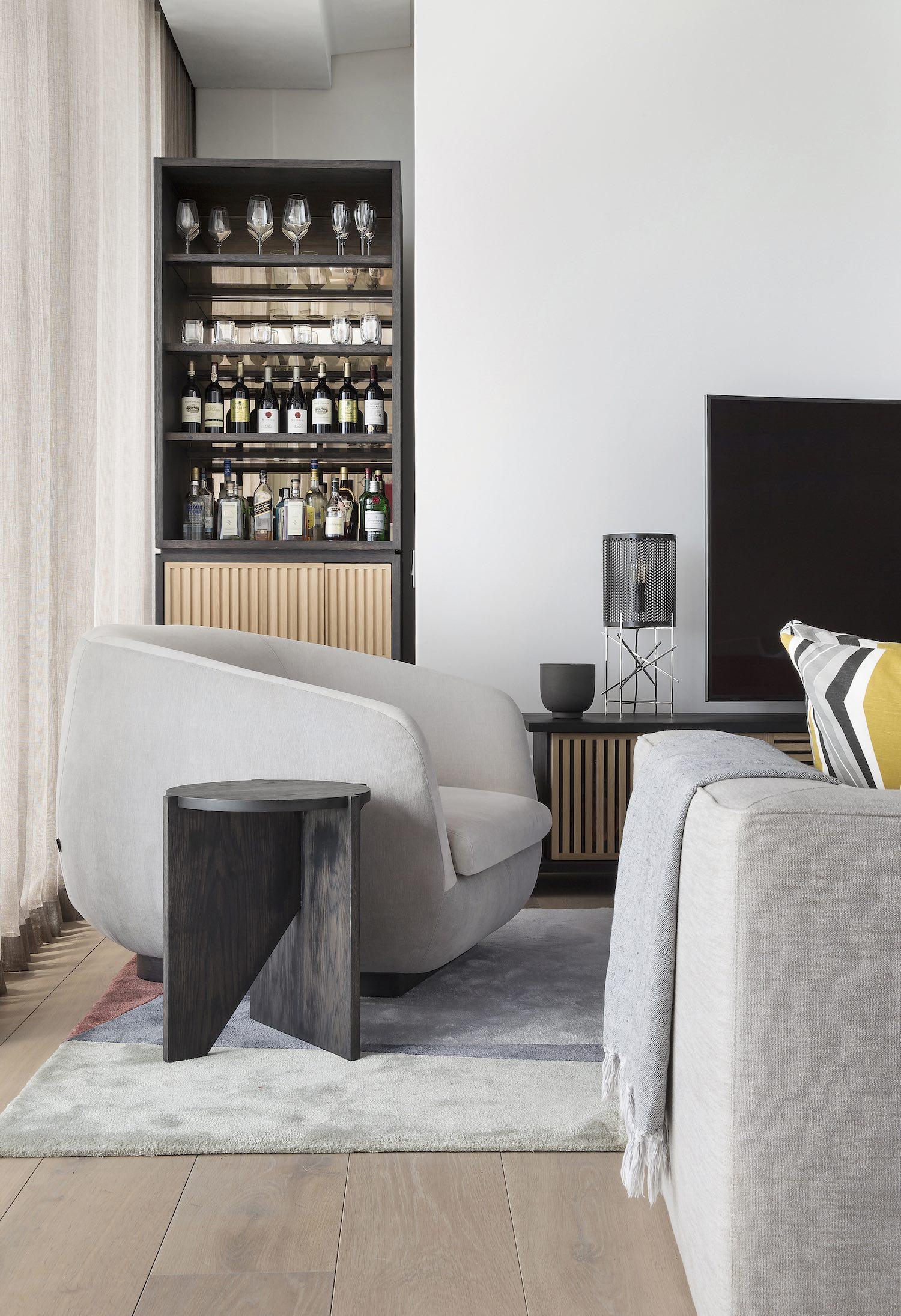 armchair near the cabin full of wine bottles