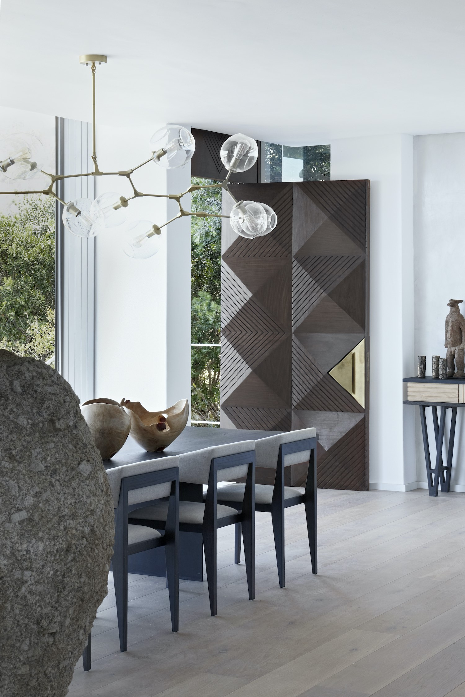 modern pendant lamp hanged over wooden dining table in living area