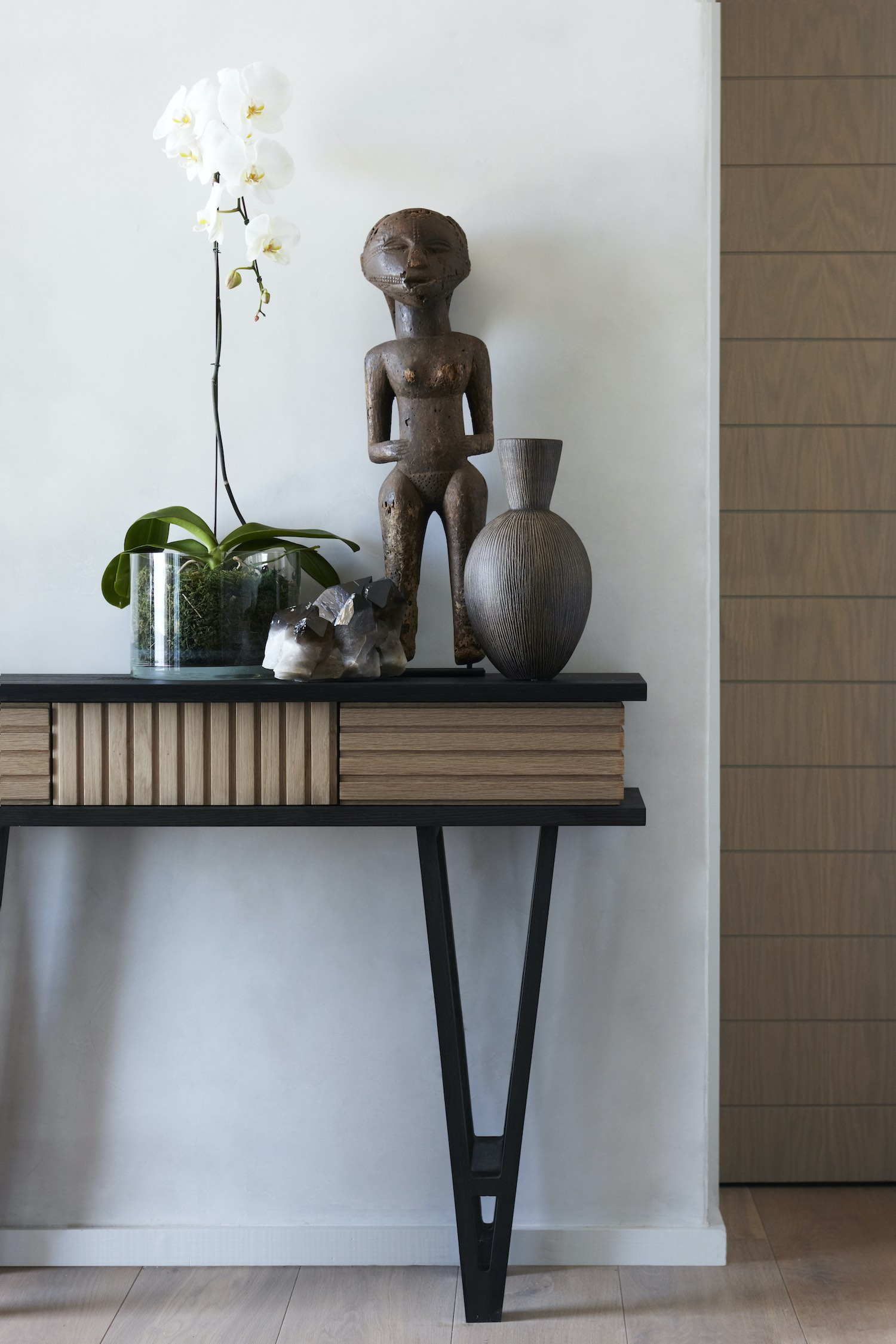 African wooden sculpture decoded over the table
