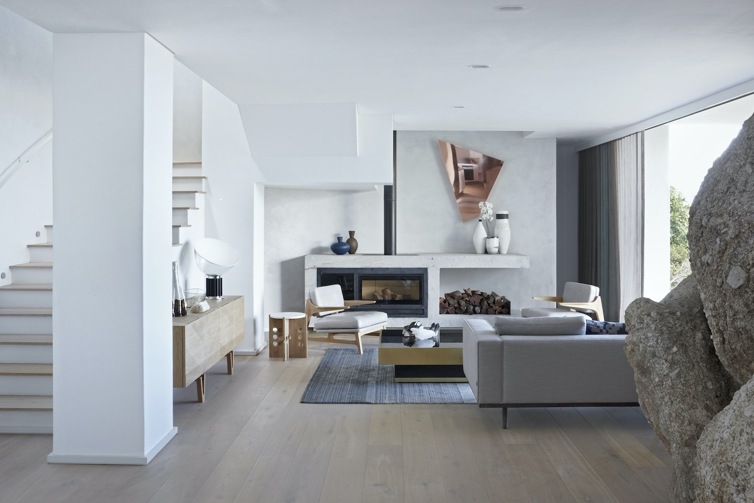 living area with comfortable sofa near fireplace