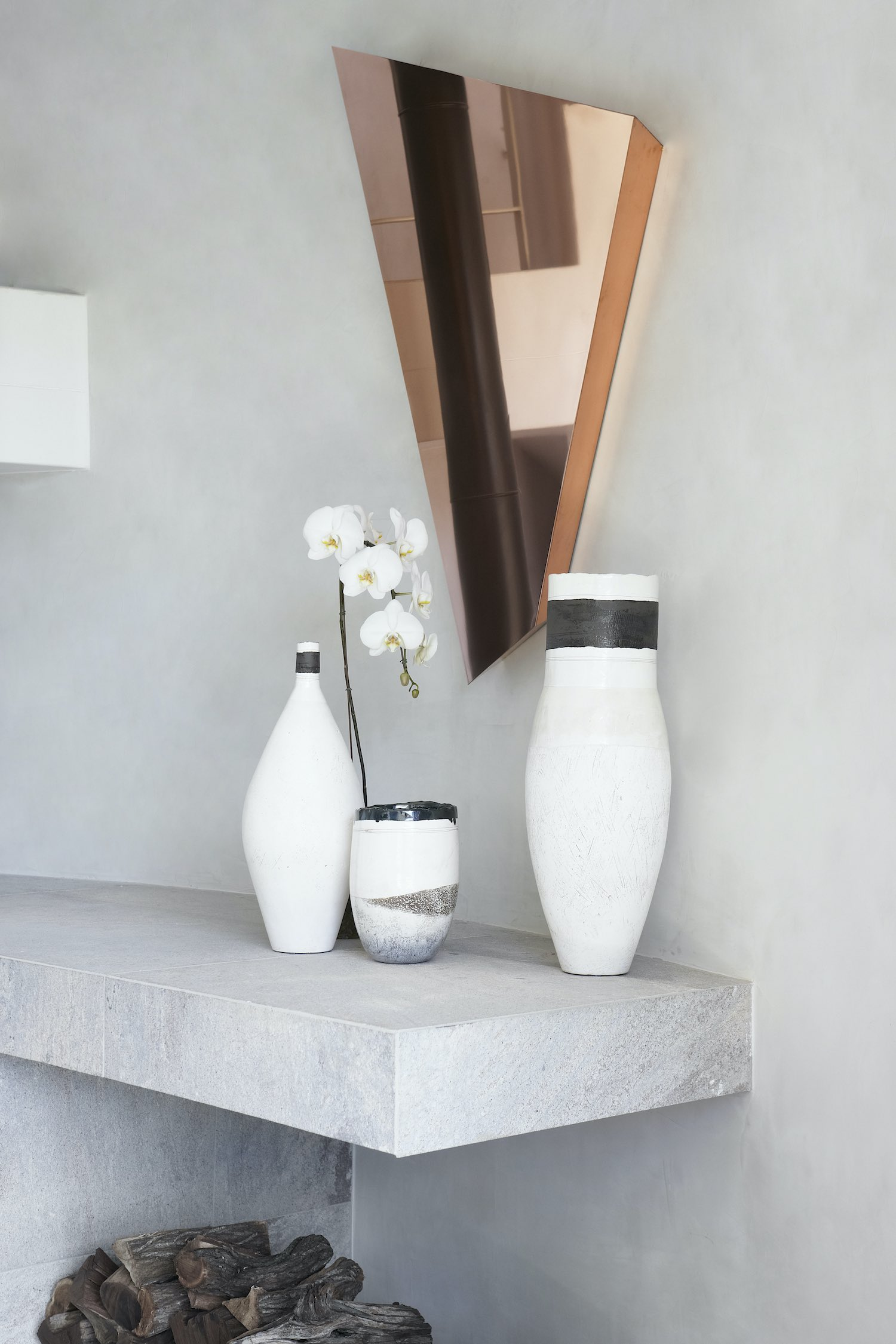home decoration with flower pots and triangular mirror