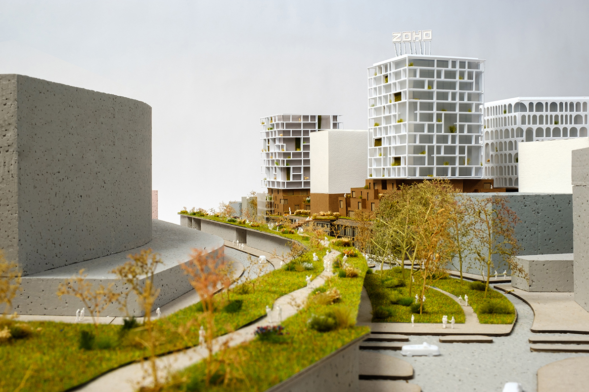 architectural model of a commercial building with green landscape