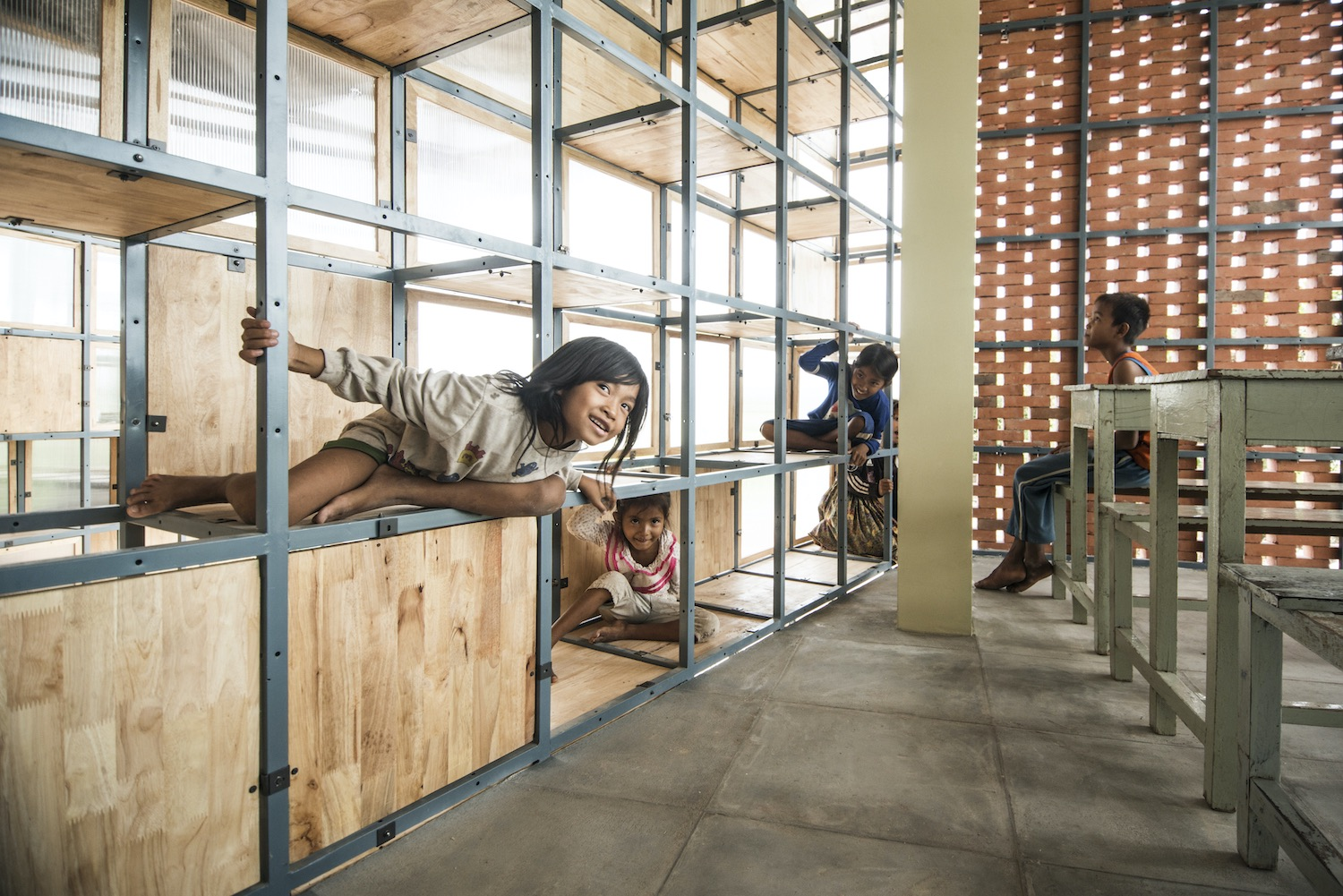 kids playing on wood pallet walls in the school