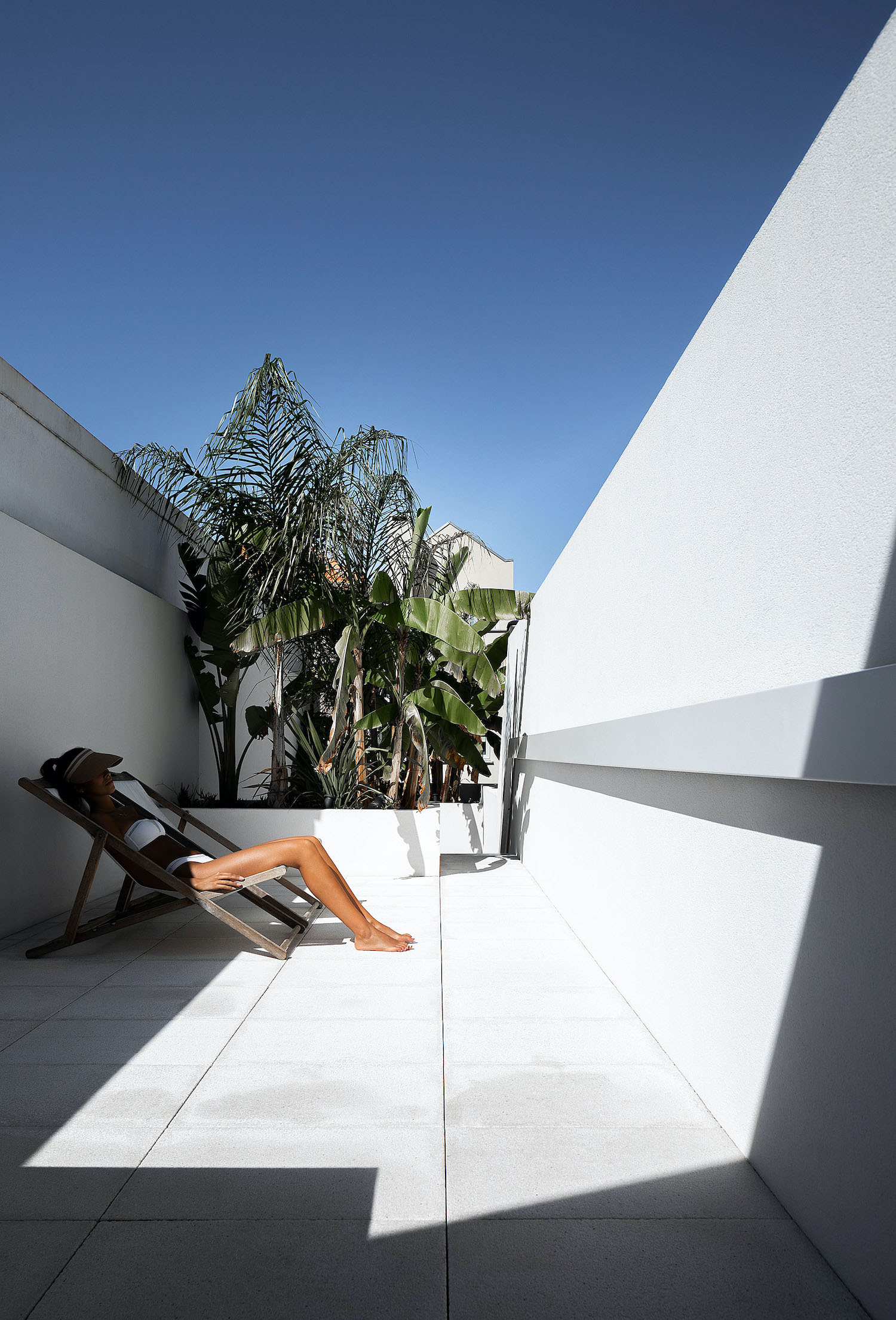 sexy girl taking sun on the roof of the house