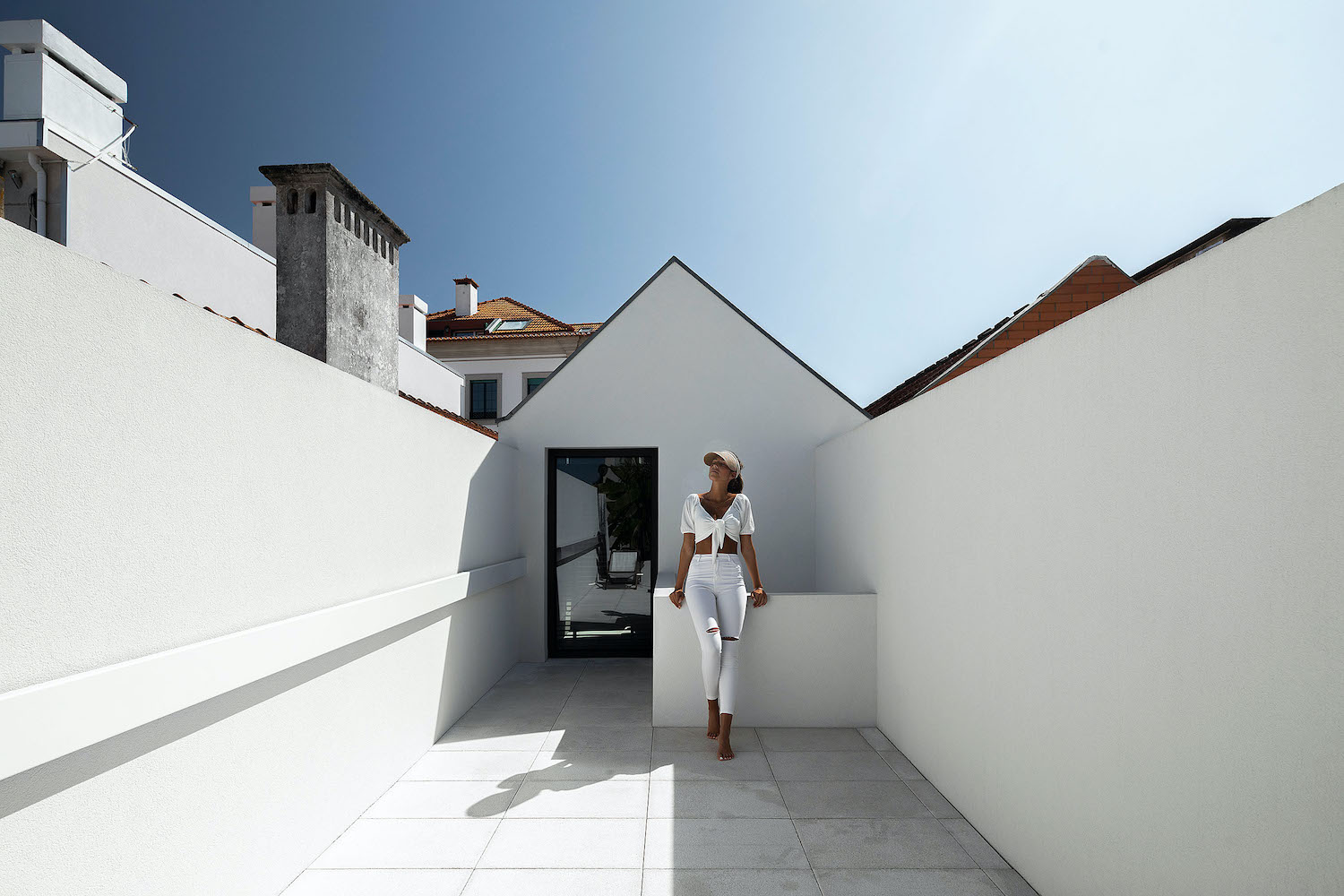 young lady in white dress on the rooftop of the house