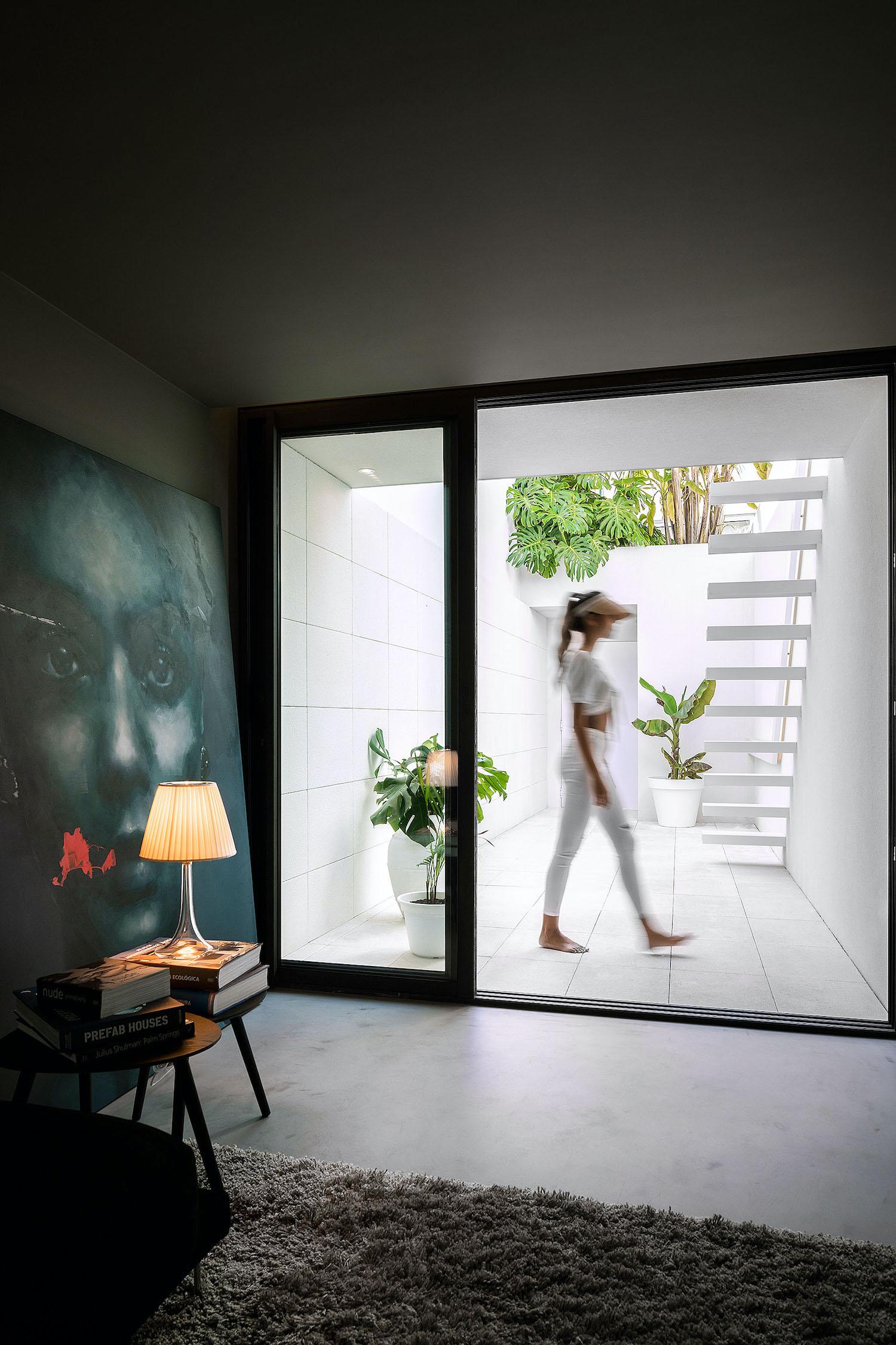 girl walking nearby window
