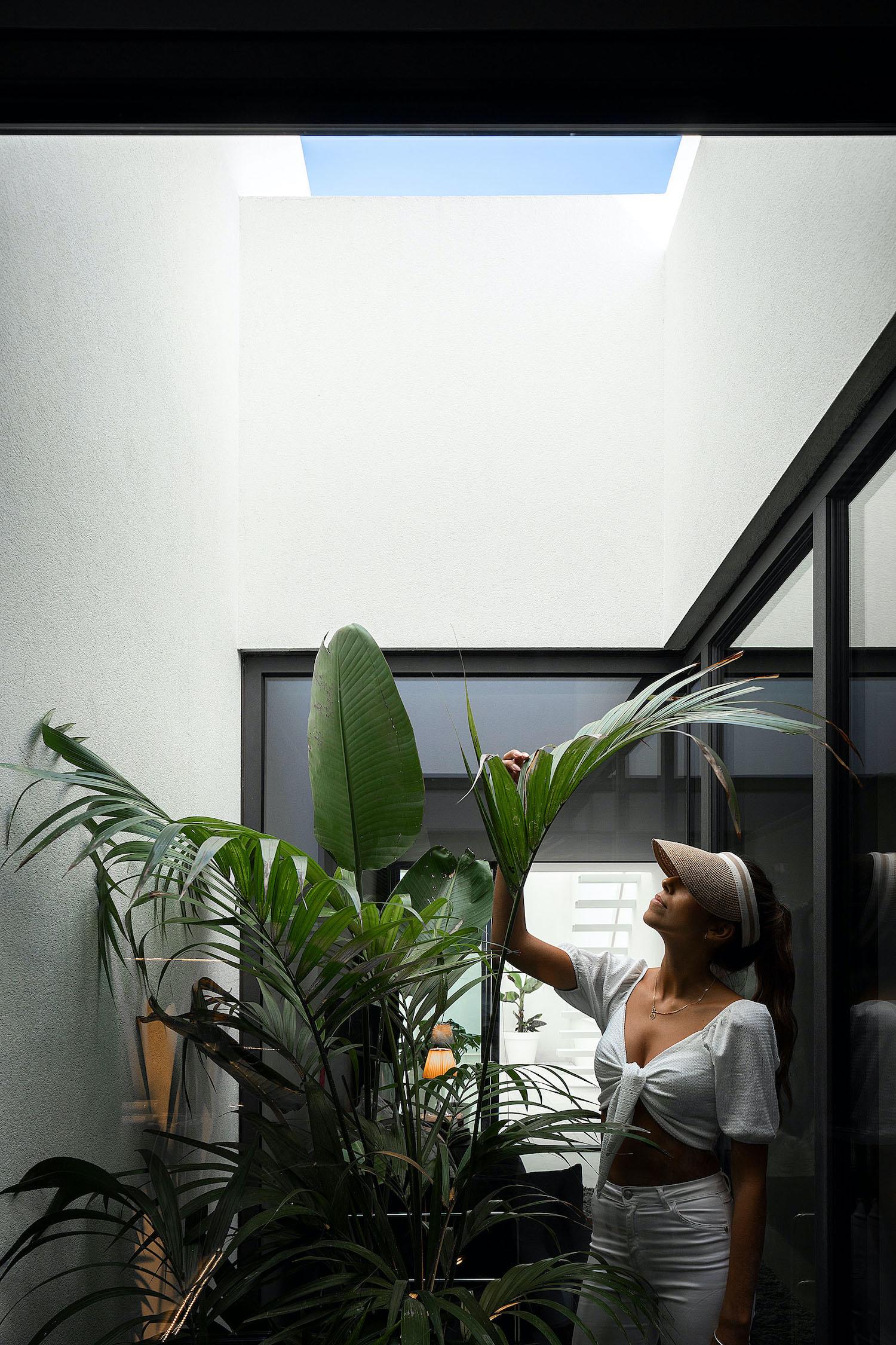 girl taking care of indoor garden plants