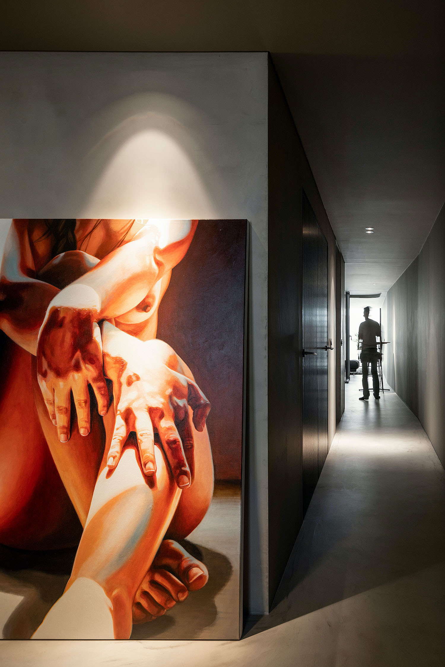 naked woman picture on the wall illuminated with artificial light