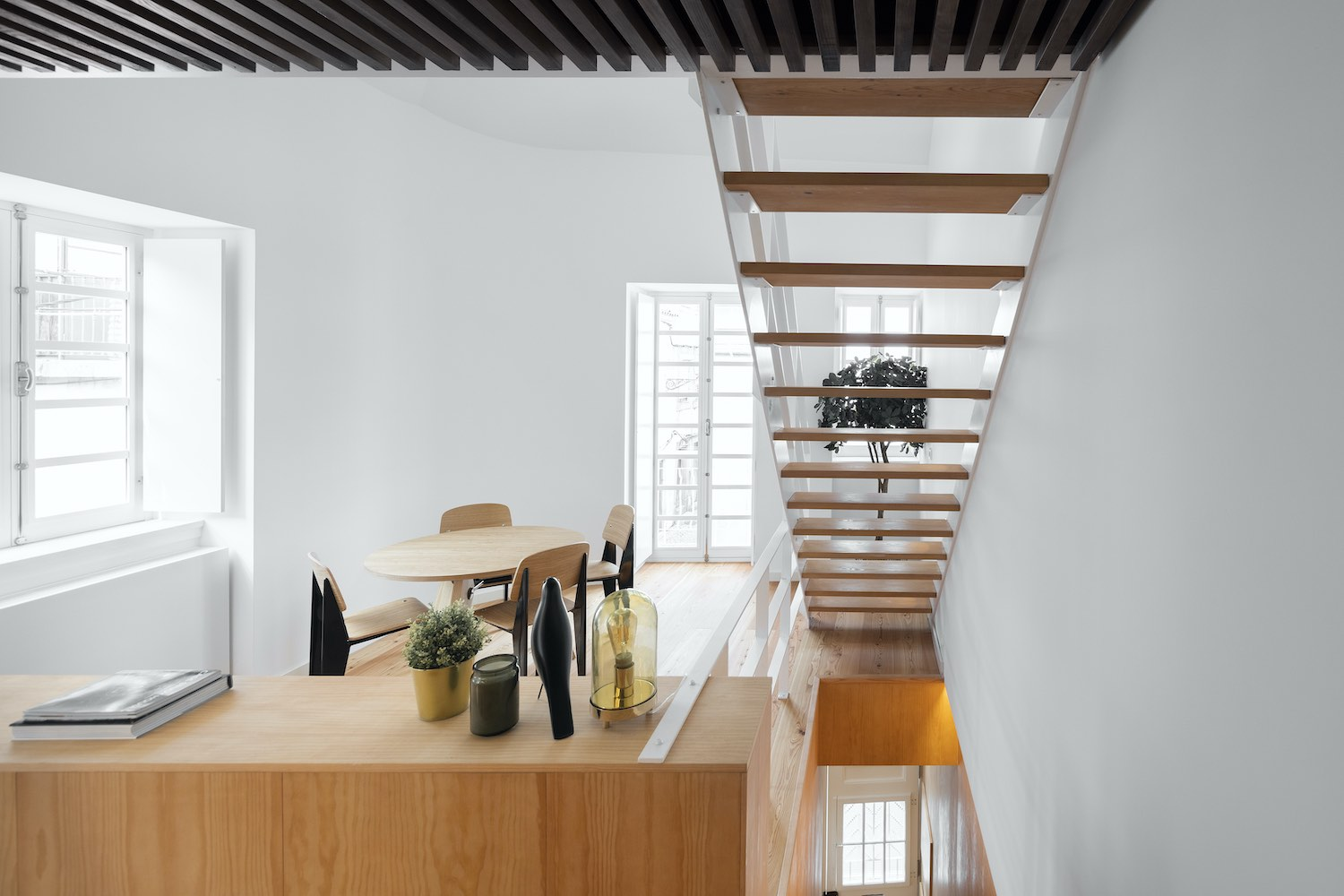 wooden staircase with steel handrail