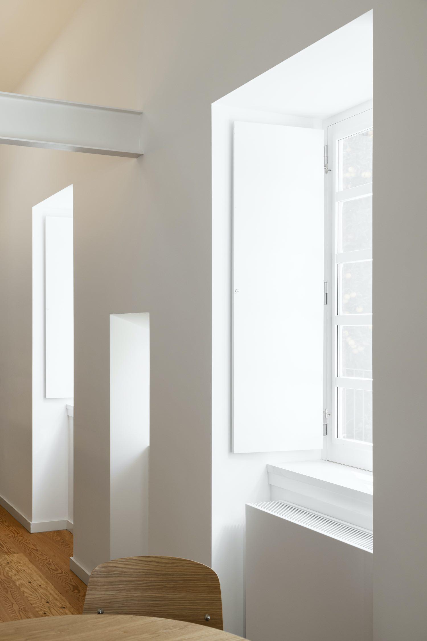 sunlight enters the room through window