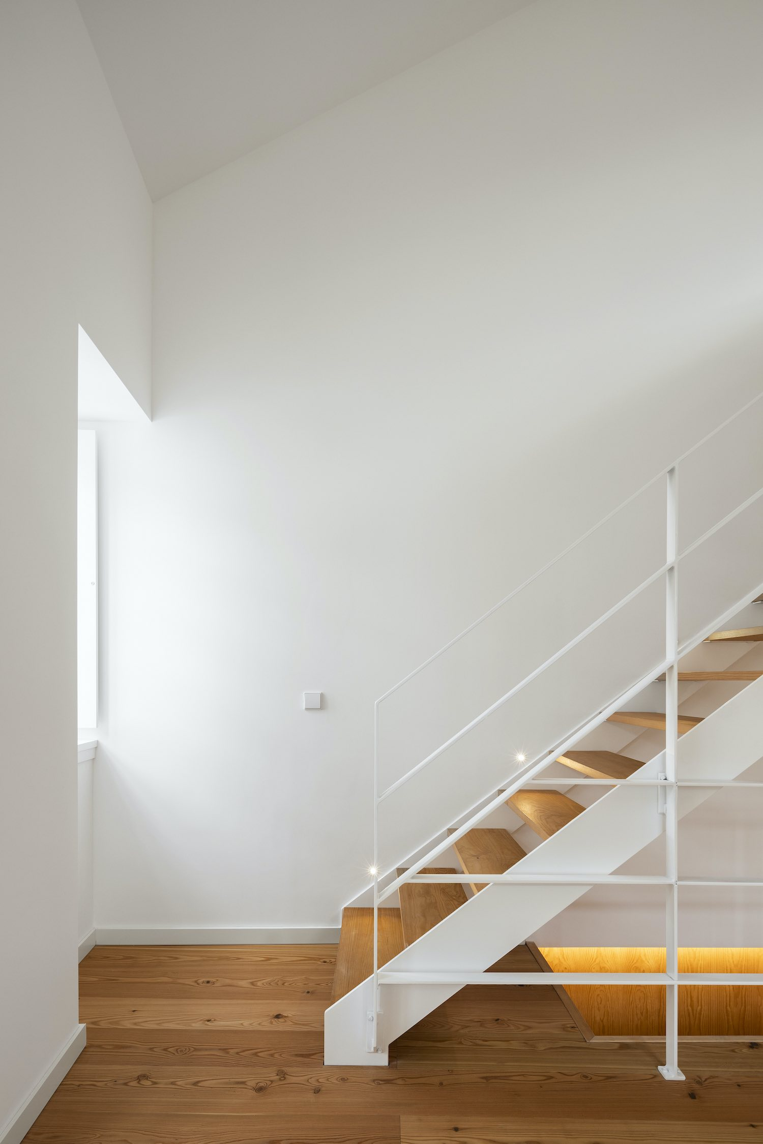 staircase with wooden steps and steel handrail