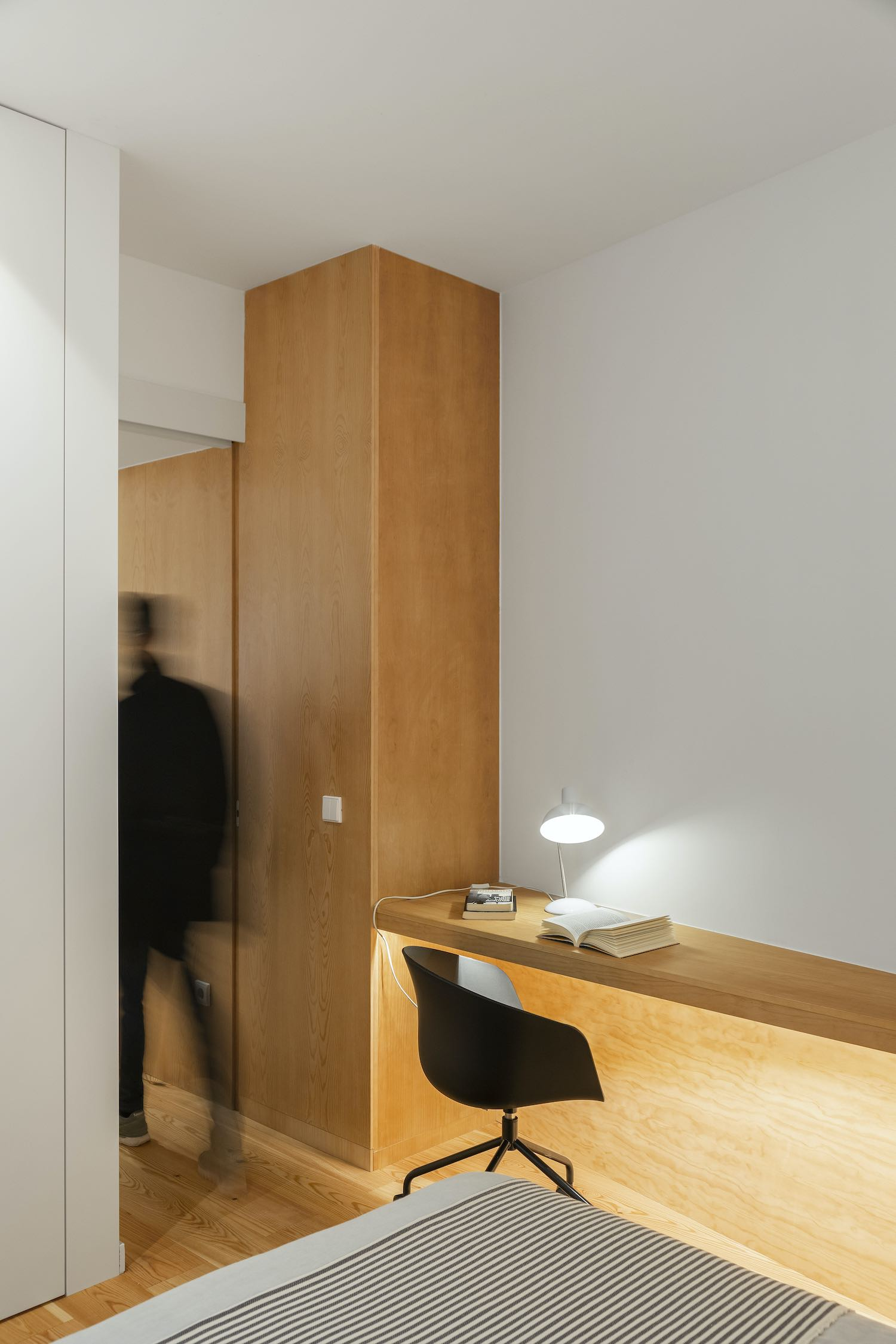 office desk with table lamp and chair
